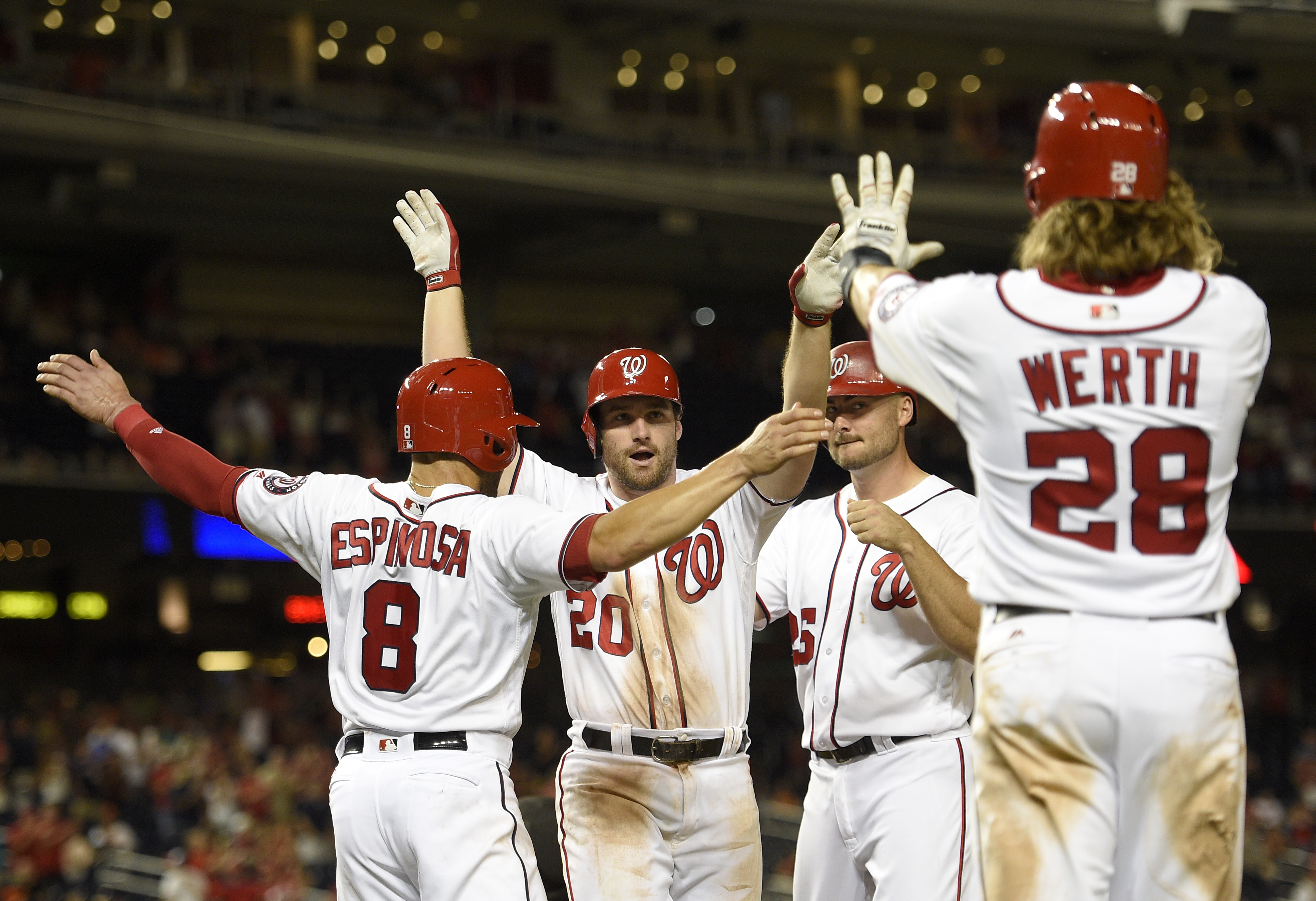 Washington Nationals' Daniel Murphy (20) celebrates his grand slam with Danny Espinosa (8), Jayson Werth (28) and Clint Robinson during the ninth inning of a baseball game against the Baltimore Orioles, Wednesday, Aug. 24, 2016, in Washington. The Orioles