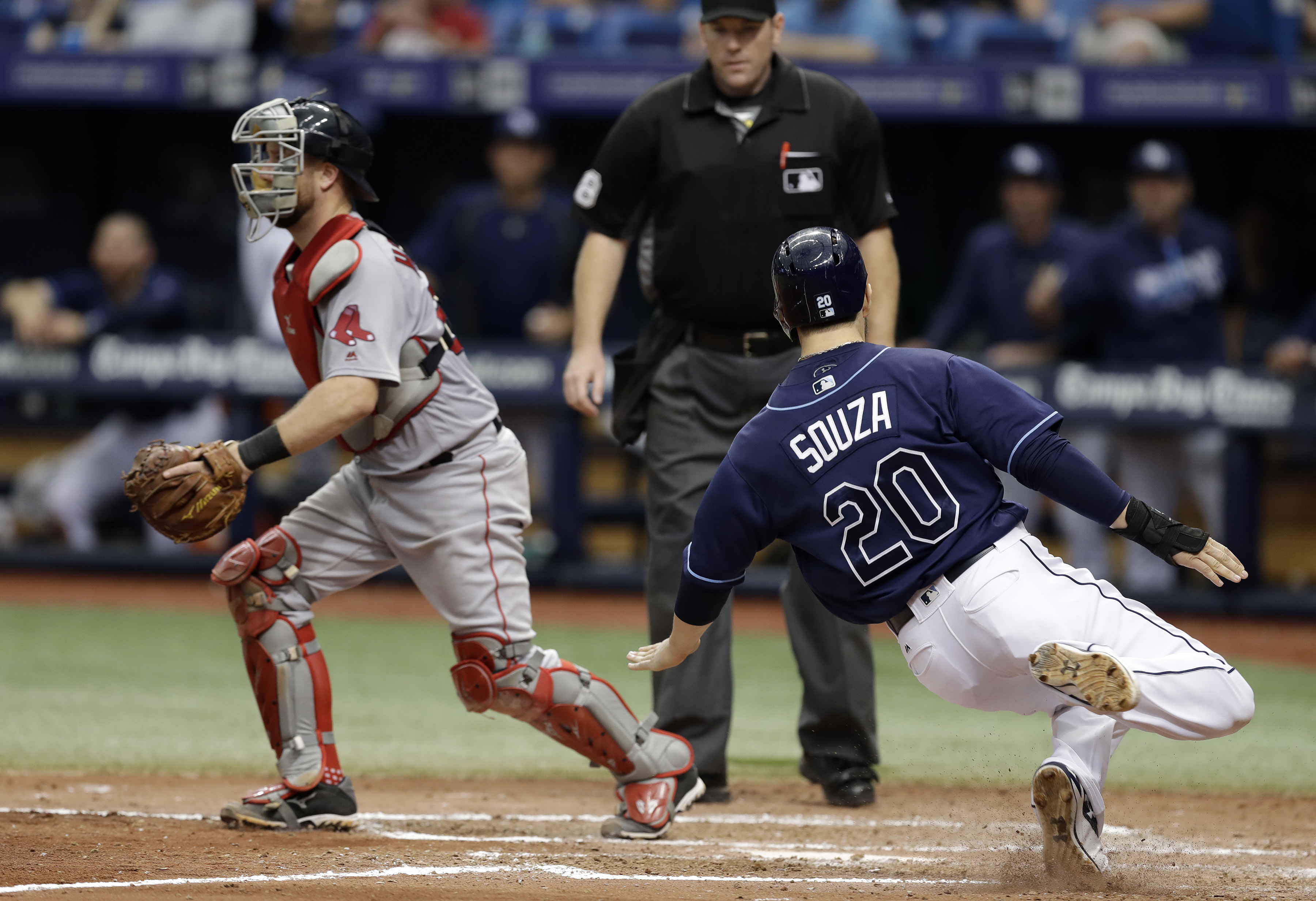Tampa Bay Rays' Steven Souza Jr. (20) slides home safely on a double by Mikie Mahtook as Boston Red Sox catcher Bryan Holaday waits for the throw during the seventh inning of a baseball game Thursday, Aug. 25, 2016, in St. Petersburg, Fla. The Rays won th