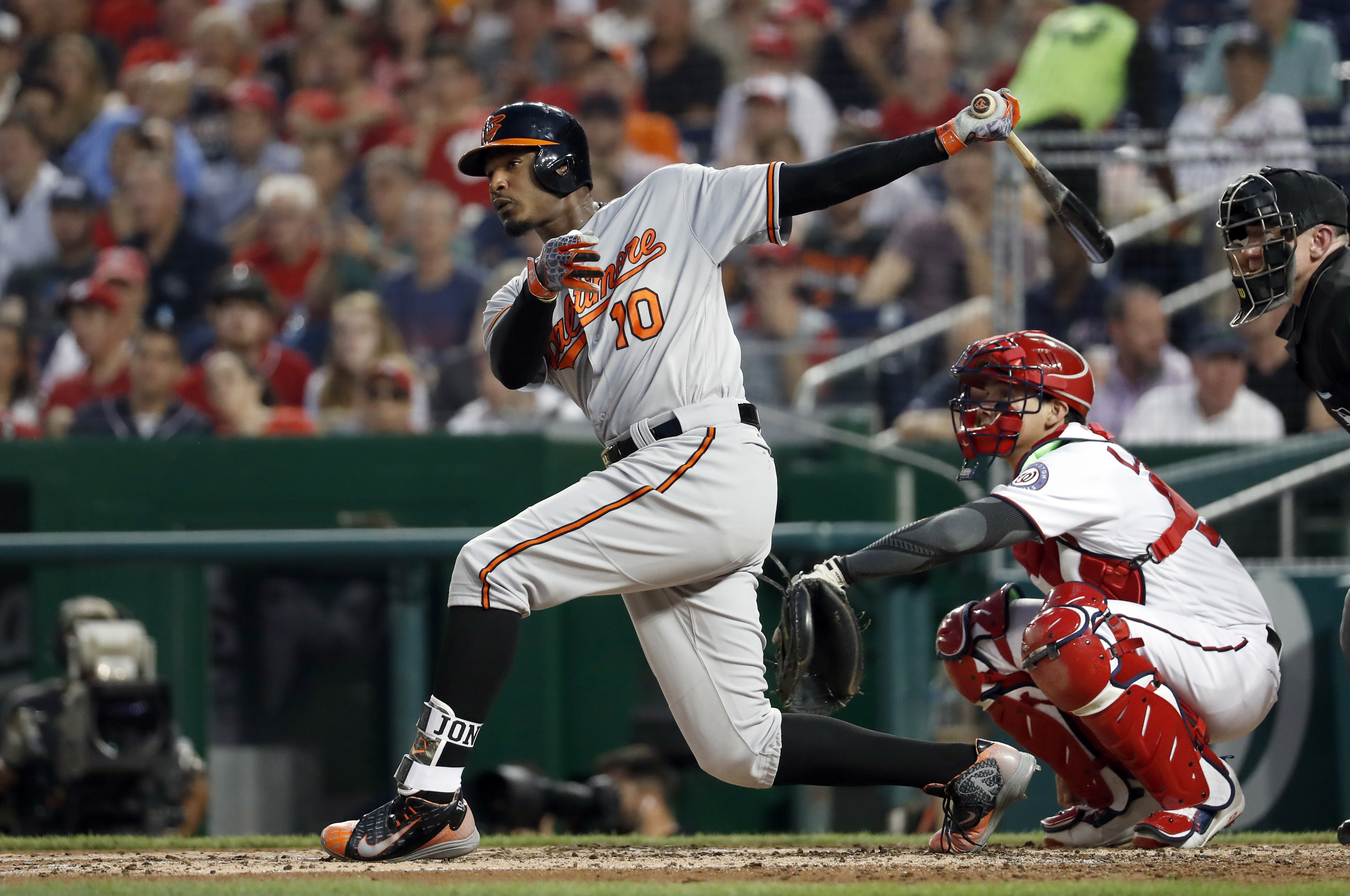 Baltimore Orioles' Adam Jones watches his hit for a double off Washington Nationals starting pitcher Max Scherzer during the fourth inning of a baseball game at Nationals Park Thursday, Aug. 25, 2016, in Washington. (AP Photo/Alex Brandon)
