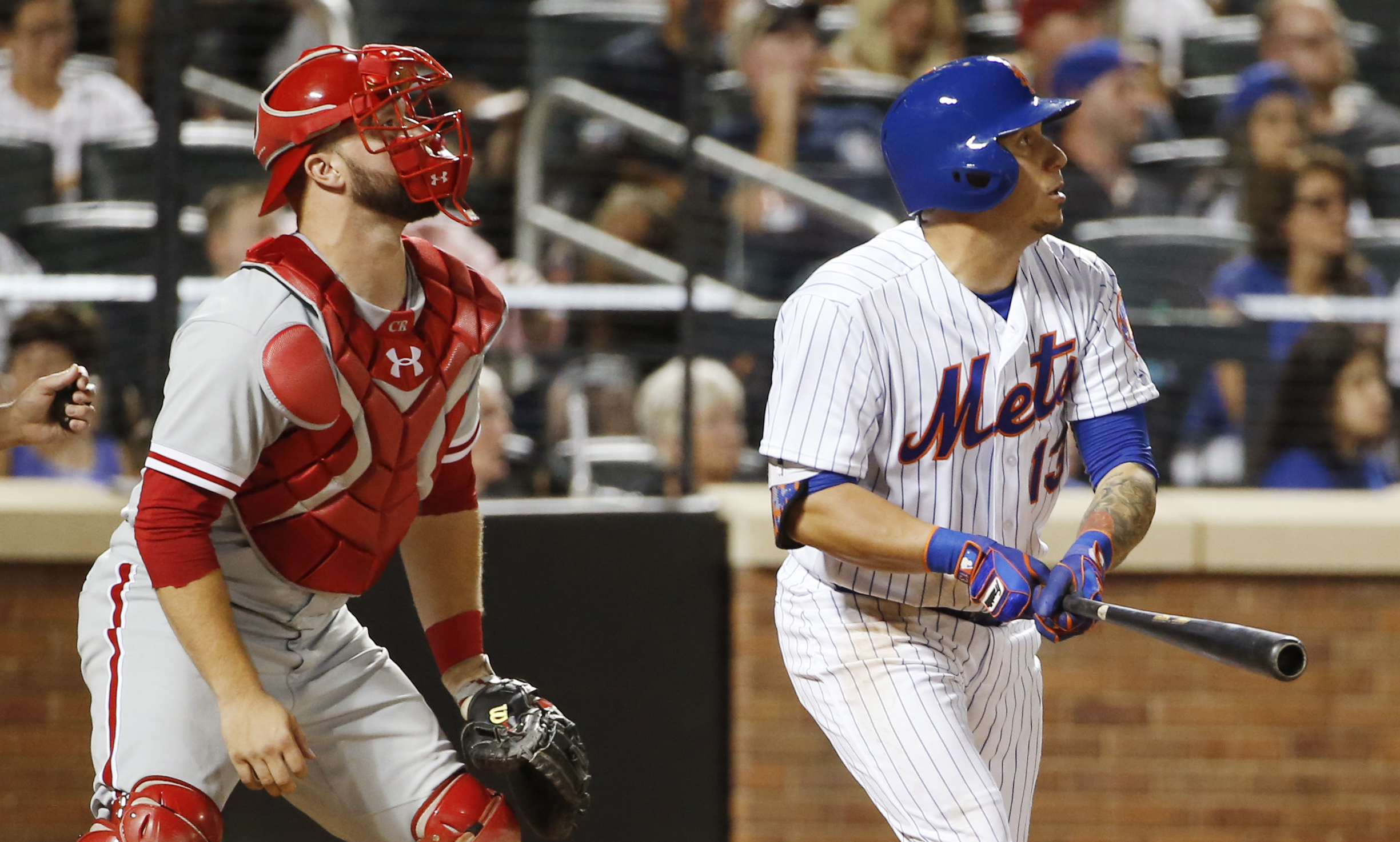 Philadelphia Phillies catcher Cameron Rupp, left, and New York Mets Asdrubal Cabrera watch Cabrera's third-inning, two-run, home run in a baseball game, Saturday, Aug. 27, 2016, in New York. (AP Photo/Kathy Willens)