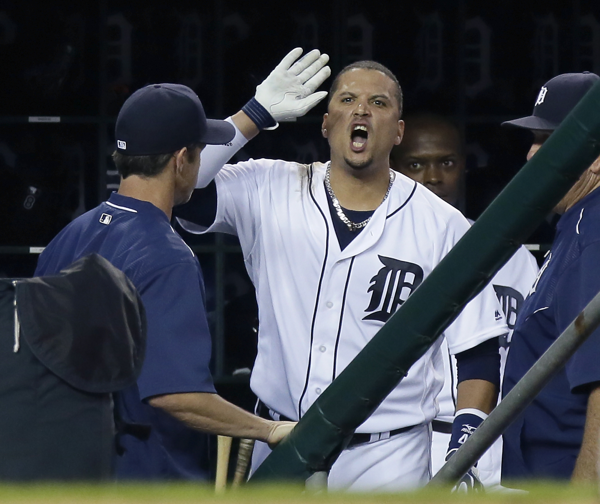 Detroit Tigers' Victor Martinez continues to yell at home plate umpire Mike Everitt following his ejection as manager Brad Ausmus, left, watches during the third inning of a baseball game against the Los Angeles Angels on Saturday, Aug. 27, 2016, in Detro