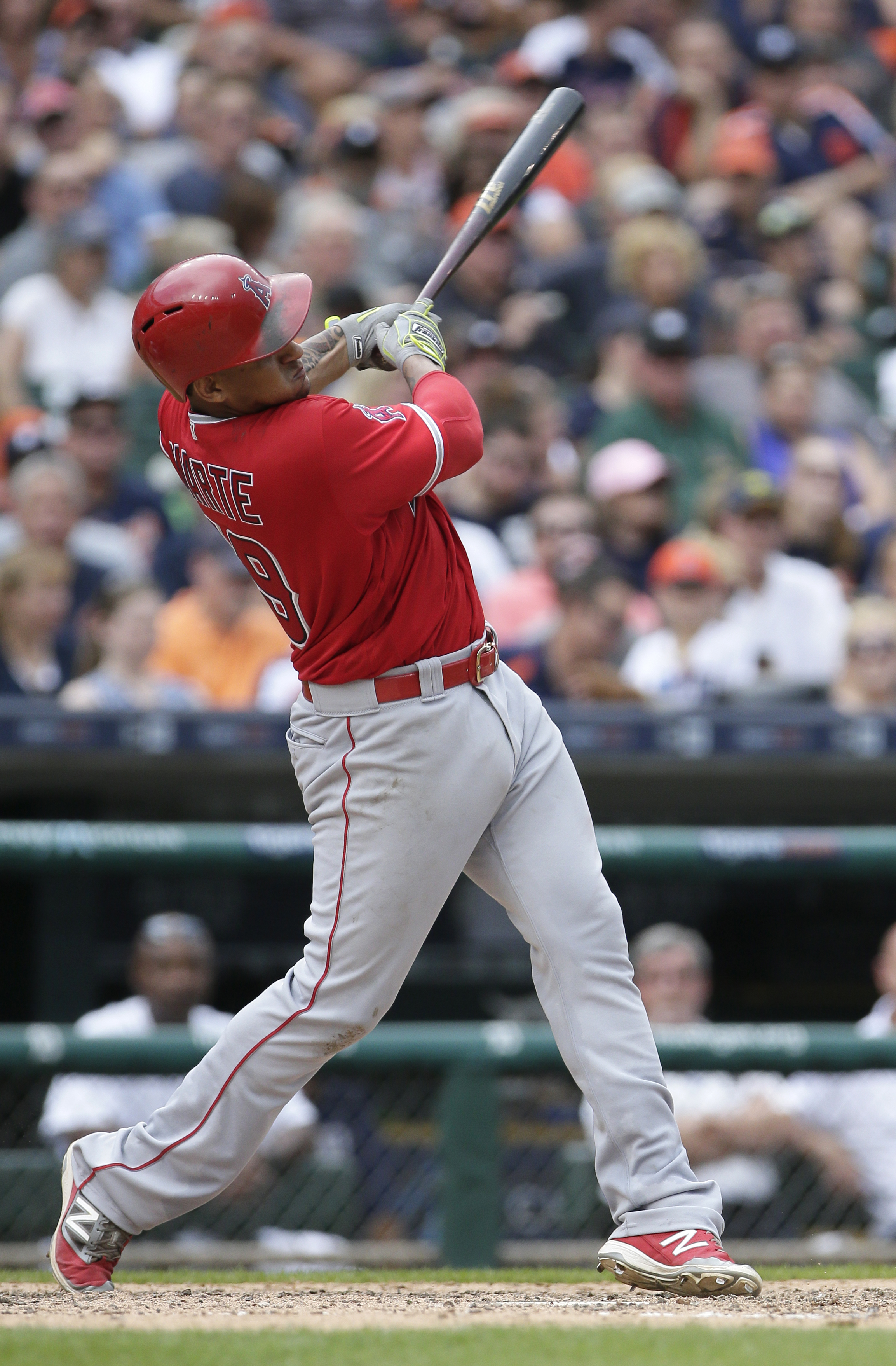 Los Angeles Angels' Jefry Marte hits a sacrifice fly ball to drive in Albert Pujols against the Detroit Tigers during the sixth inning of a baseball game Sunday, Aug. 28, 2016, in Detroit. (AP Photo/Duane Burleson)
