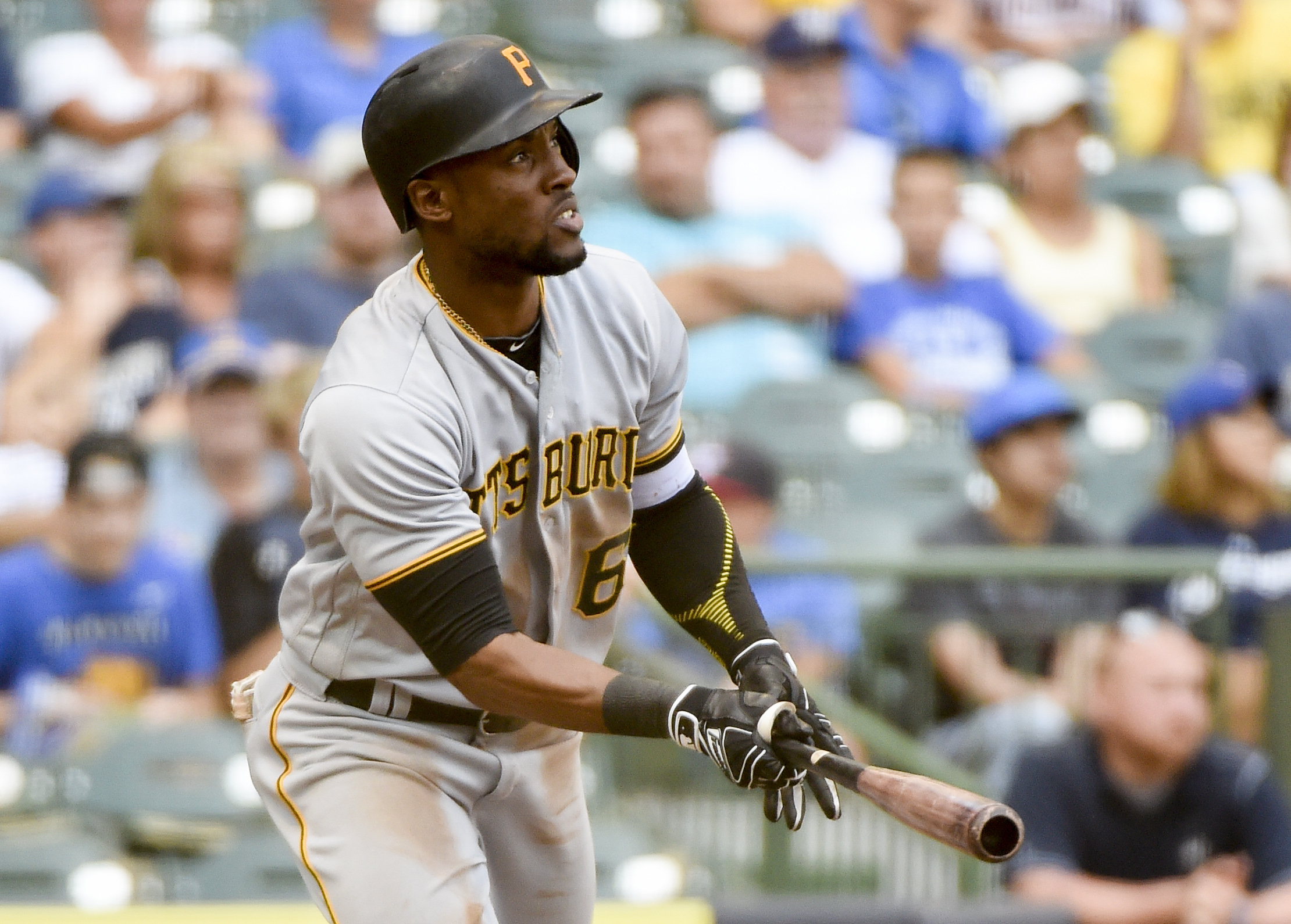 Pittsburgh Pirates' Starling Marte watches after hitting a solo home run against Milwaukee Brewers pitcher Carlos Torres during the eighth inning of a baseball game, Sunday, Aug. 28, 2016, in Milwaukee. (AP Photo/Benny Sieu)