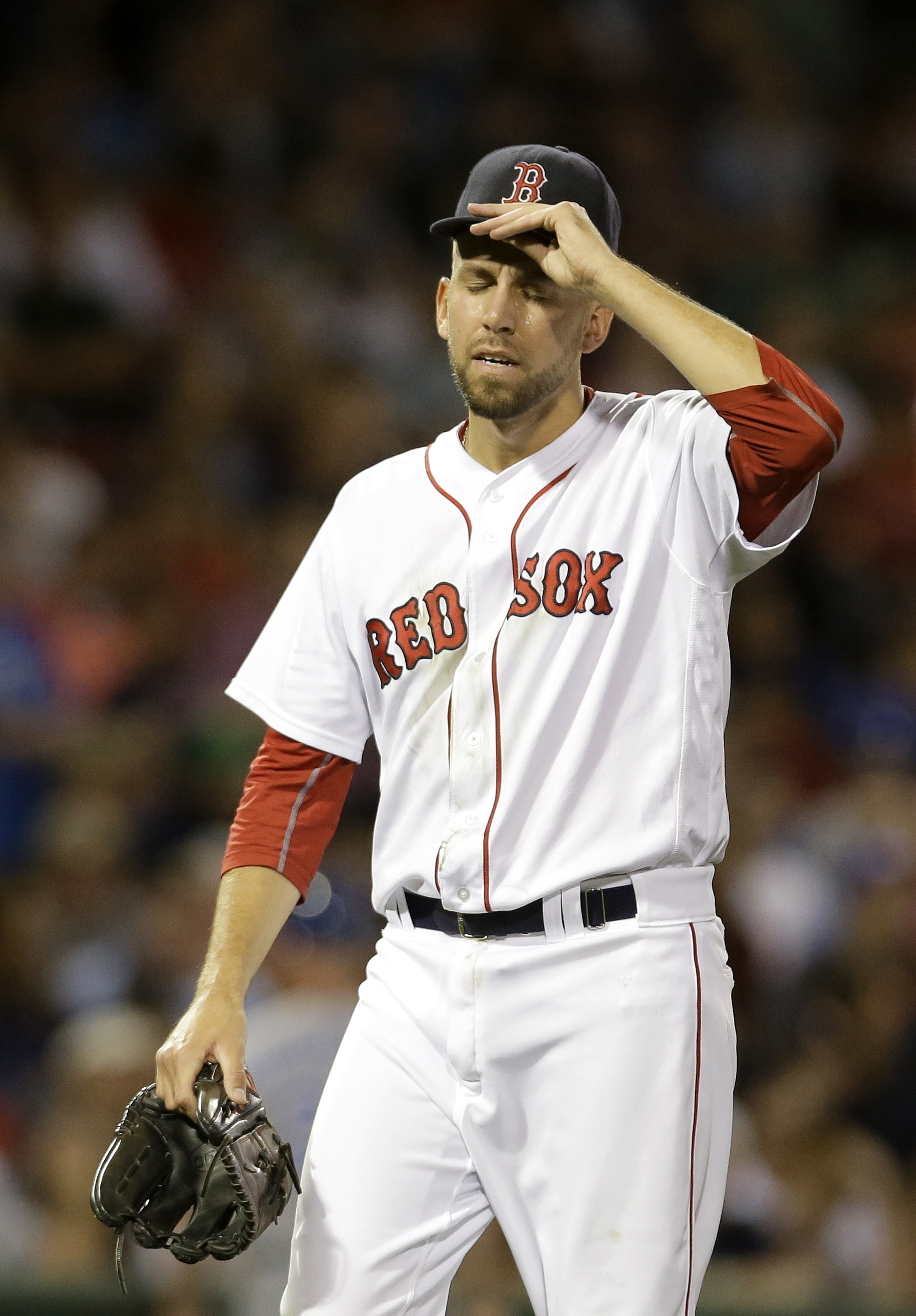 Boston Red Sox relief pitcher Matt Barnes walks toward the dugout after giving up runs to the Kansas City Royals in the sixth inning of a baseball game, Sunday, Aug. 28, 2016, in Boston. (AP Photo/Steven Senne)