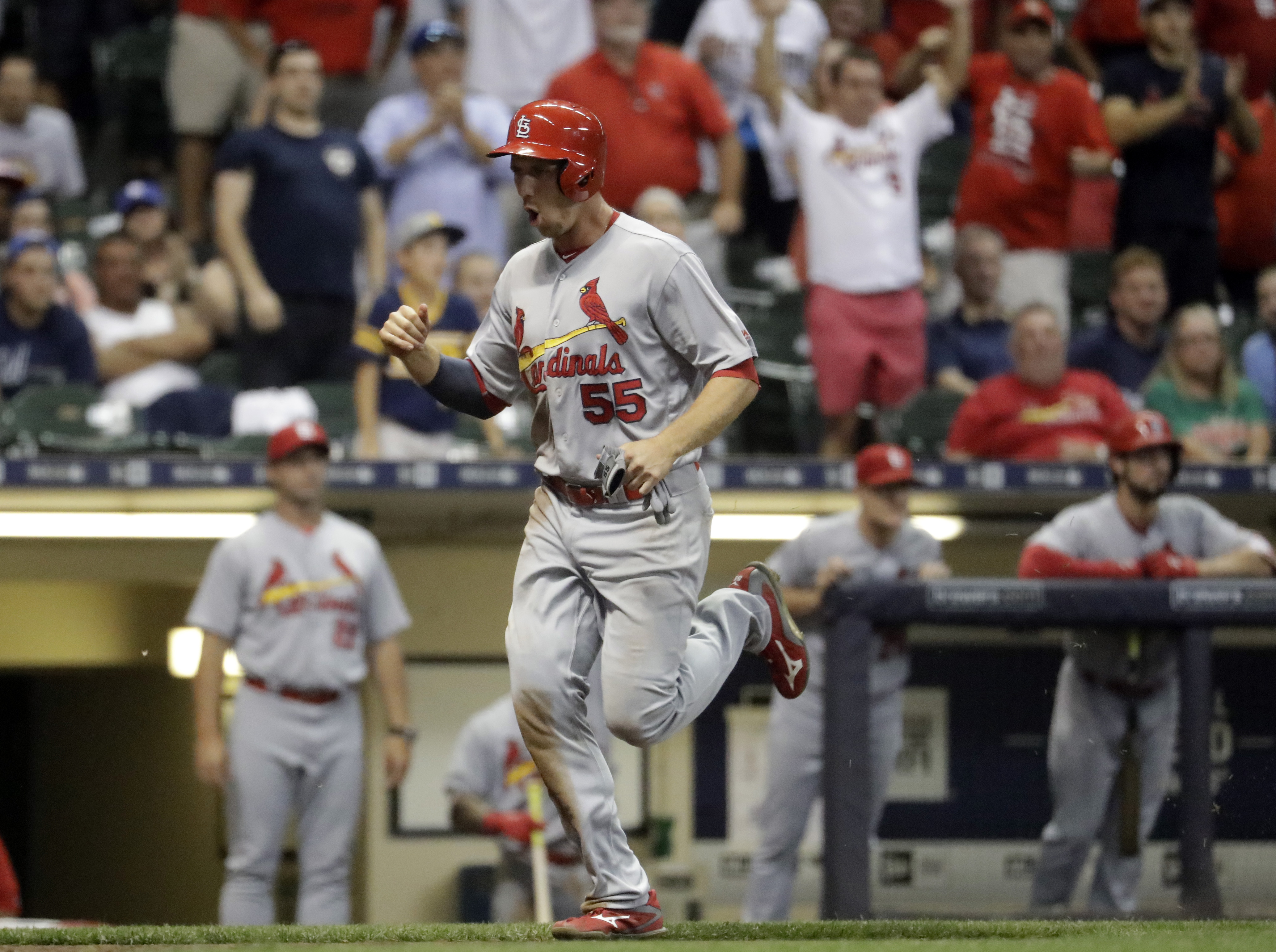 St. Louis Cardinals' Stephen Piscotty reacts as he scores from second on a wild throw on a bunt by Yadier Molina during the ninth inning of a baseball game against the Milwaukee Brewers Monday, Aug. 29, 2016, in Milwaukee. (AP Photo/Morry Gash)
