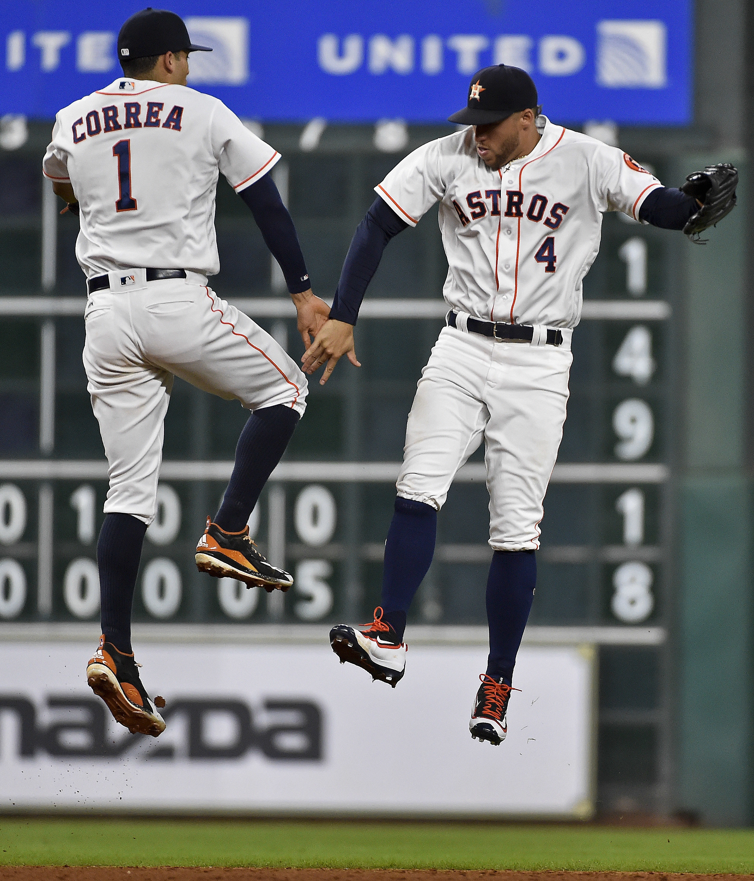 Houston Astros' Carlos Correa (1) and George Springer celebrate Houston's 6-0 victory over the Oakland Athletics in a baseball game, Monday, Aug. 29, 2016, in Houston. (AP Photo/Eric Christian Smith)