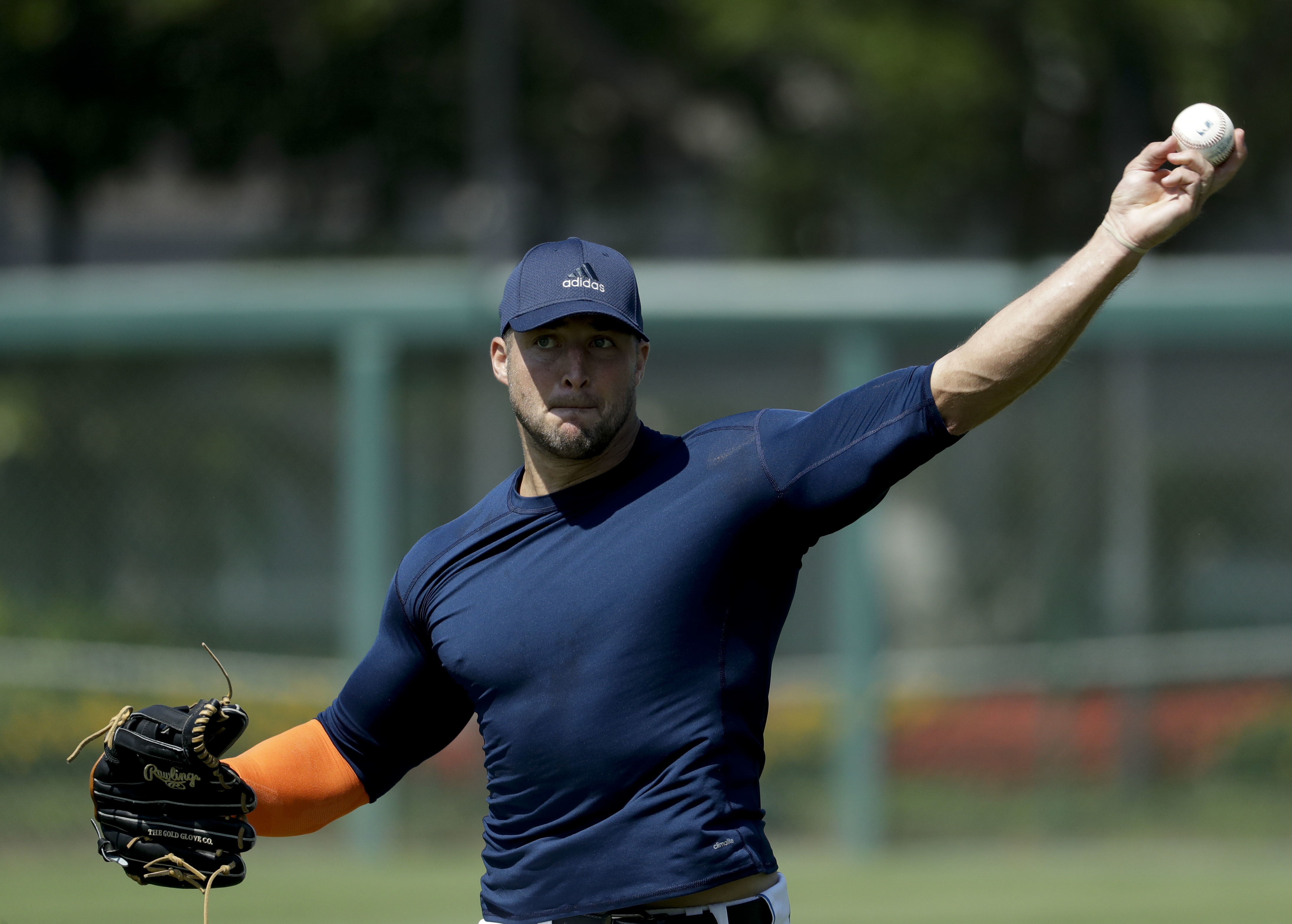 Former NFL quarterback, Tim Tebow works out for baseball scouts and the media during a showcase on the campus of the University of Southern California, Tuesday, Aug. 30, 2016 in Los Angeles. The Heisman Trophy winner works out for a big gathering of scout