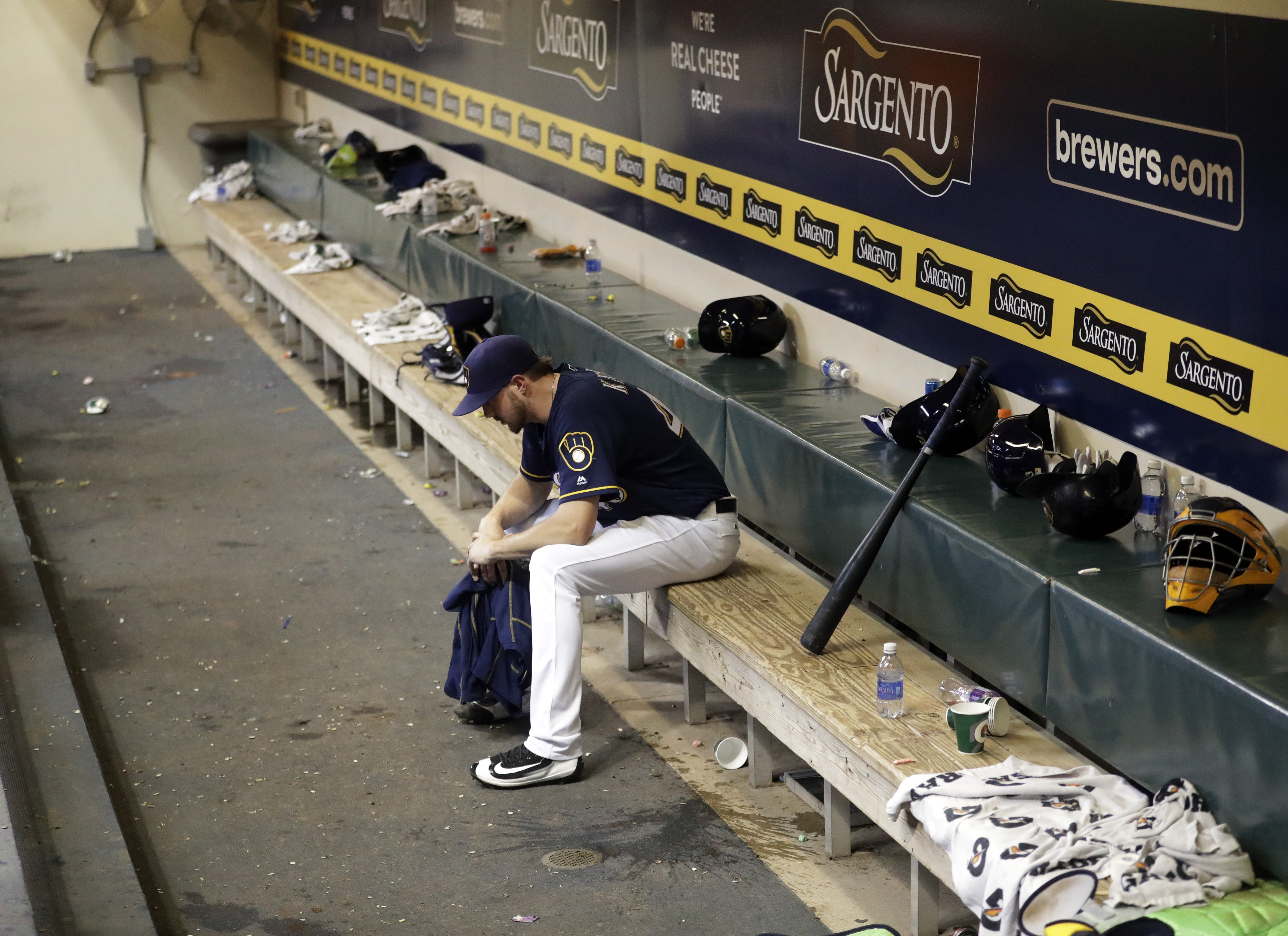 St. Louis Cardinals relief pitcher Kevin Siegrist sits alone in the dugout after the 10th inning of a baseball game against the St. Louis Cardinals Tuesday, Aug. 30, 2016, in Milwaukee. The Cardinals won 2-1. (AP Photo/Morry Gash)