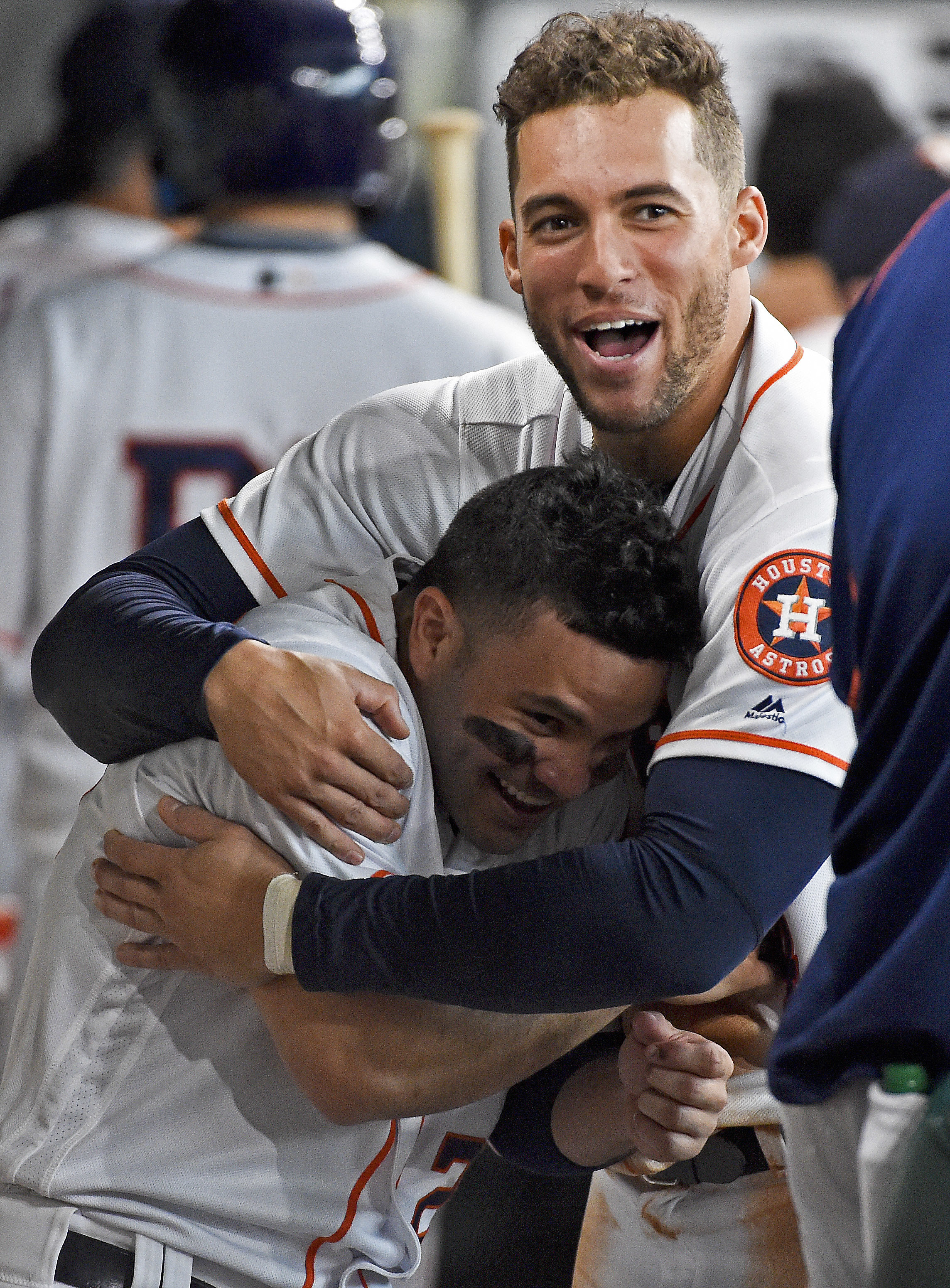 Houston Astros' George Springer, right, hugs Jose Altuve after Altuve scored the go-ahead run in the eighth inning of a baseball game against the Oakland Athletics, Wednesday, Aug. 31, 2016, in Houston. The Astros won 4-3. (AP Photo/Eric Christian Smith)