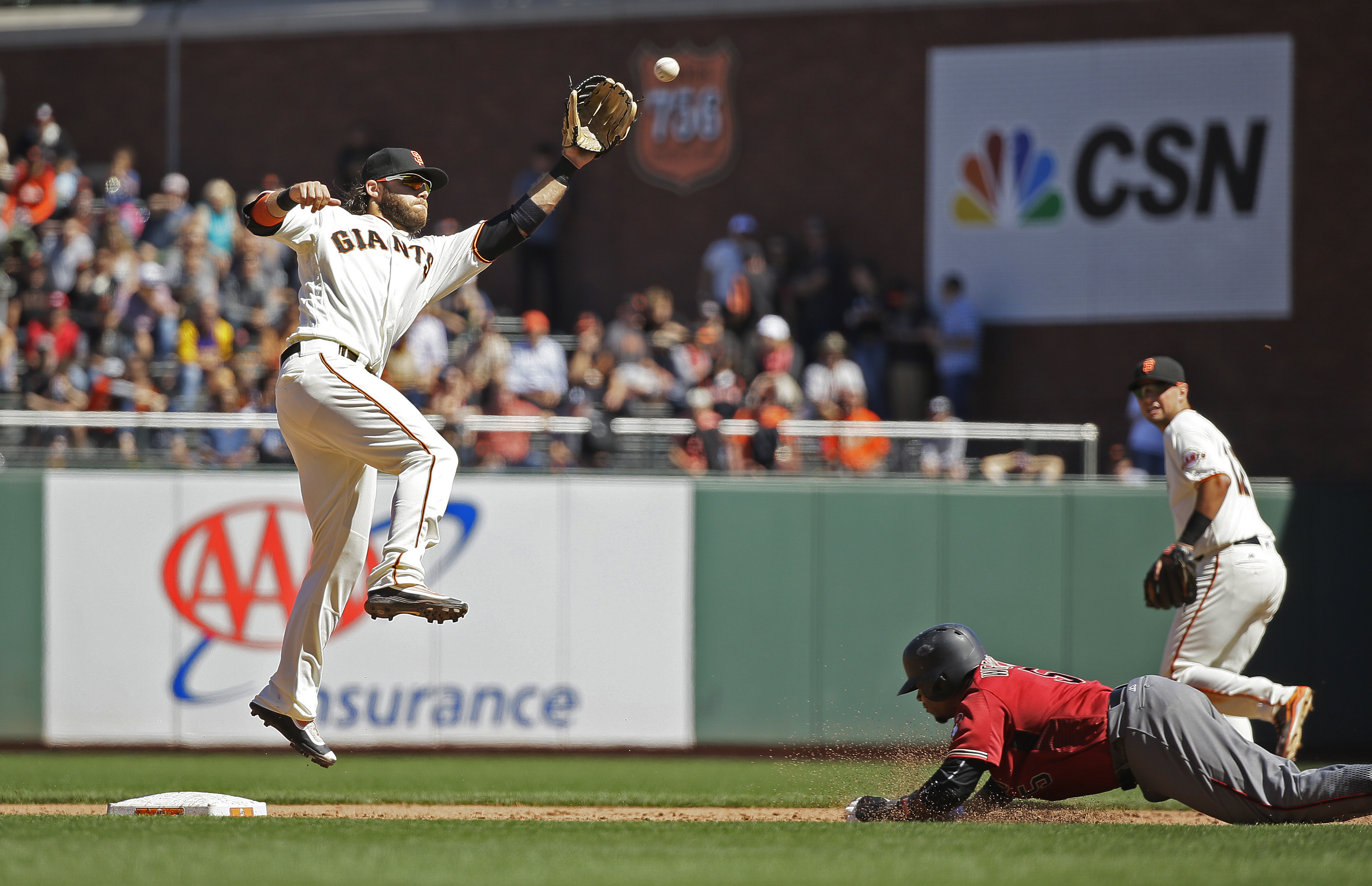 Arizona Diamondbacks' Rickie Weeks, right, goes sliding to steal second base as San Francisco Giants shortstop Brandon Crawford leaps for the throw in the sixth inning of a baseball game Wednesday, Aug. 31, 2016, in San Francisco. (AP Photo/Eric Risberg)