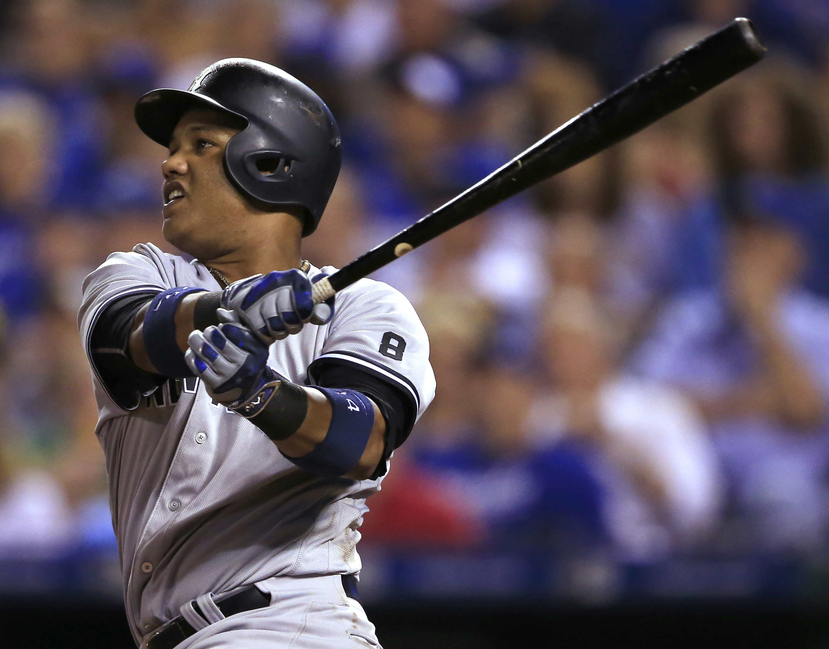 New York Yankees' Starlin Castro watches his three-run home run off Kansas City Royals starting pitcher Ian Kennedy during the sixth inning of a baseball game at Kauffman Stadium in Kansas City, Mo., Wednesday, Aug. 31, 2016. (AP Photo/Orlin Wagner)