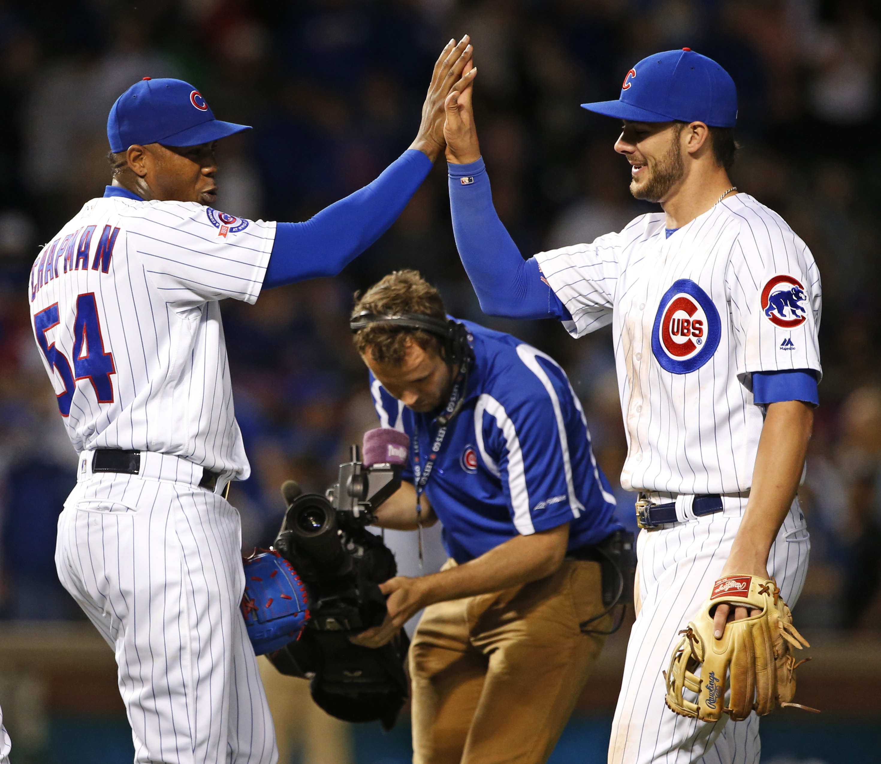 Chicago Cubs closer Aroldis Chapman, left, celebrates with Kris Bryant after the Cubs defeated the Pittsburgh Pirates 6-5 in a baseball game Wednesday, Aug. 31, 2016, in Chicago. (AP Photo/Nam Y. Huh)