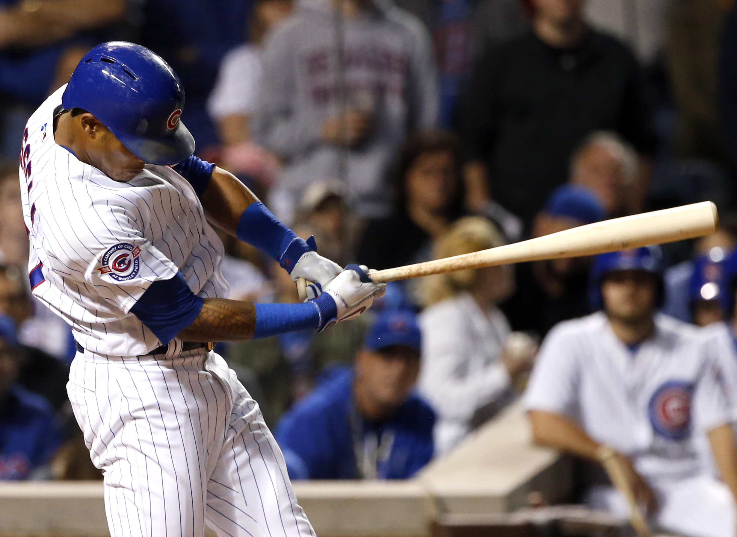 Chicago Cubs' Addison Russell hits a two-run single against the San Francisco Giants during the seventh inning of a baseball game Thursday, Sept. 1, 2016, in Chicago. (AP Photo/Nam Y. Huh)