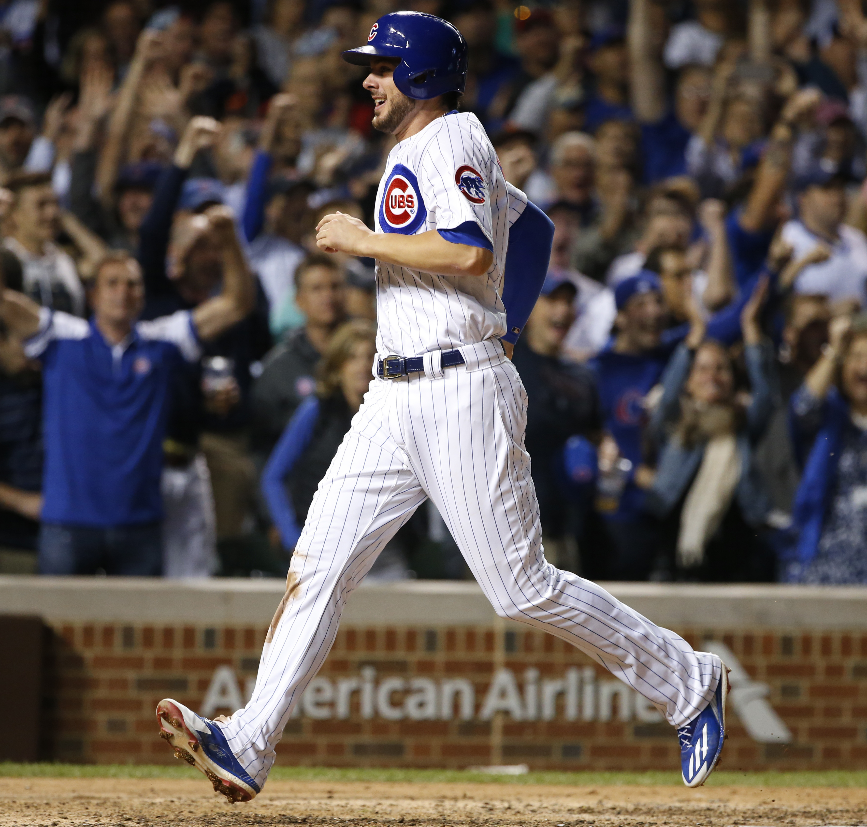Chicago Cubs' Kris Bryant scores on a single by Addison Russell during the seventh inning of a baseball game against the San Francisco Giants, Thursday, Sept. 1, 2016, in Chicago. (AP Photo/Nam Y. Huh)
