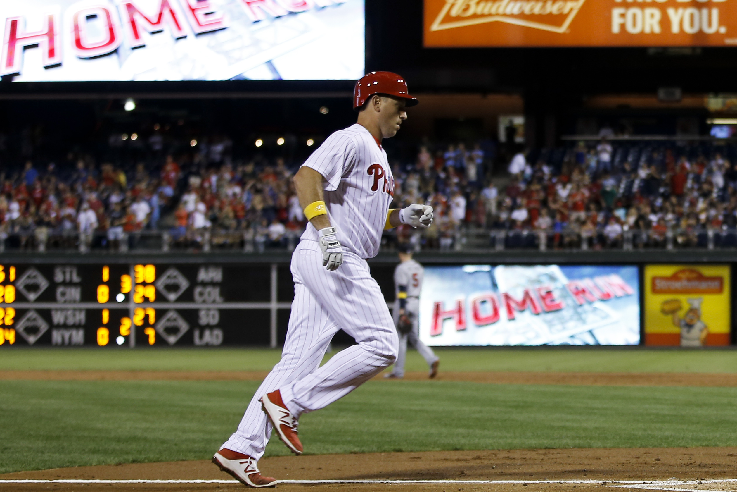 Philadelphia Phillies' A.J. Ellis rounds the bases after hitting a three-run home run off Atlanta Braves starting pitcher Joel De La Cruz during the second inning of a baseball game, Friday, Sept. 2, 2016, in Philadelphia. (AP Photo/Dake Kang)