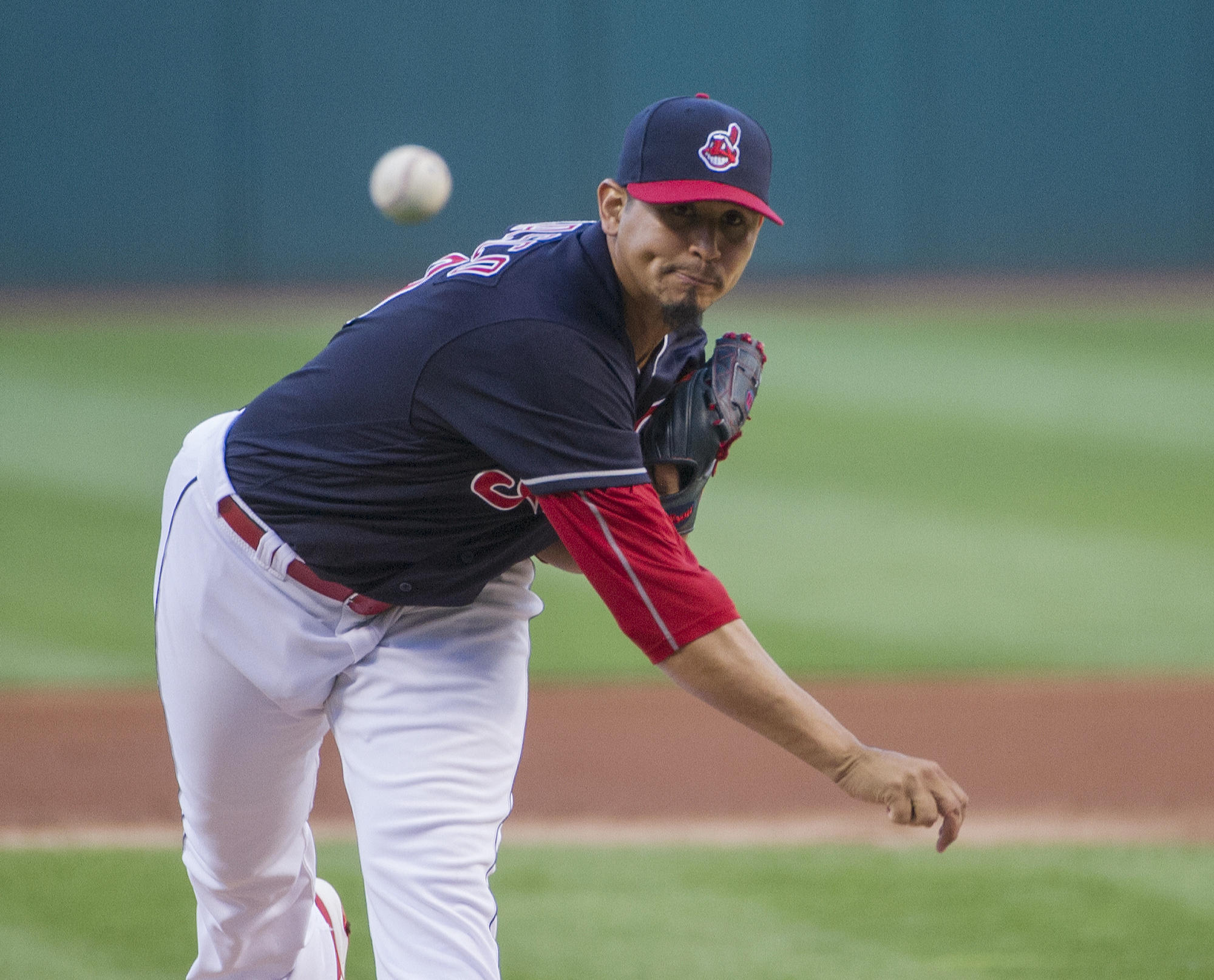 Cleveland Indians starting pitcher Carlos Carrasco delivers to a Miami Marlins batter during the first inning of a baseball game in Cleveland, Friday, Sept. 2, 2016. (AP Photo/Phil Long)