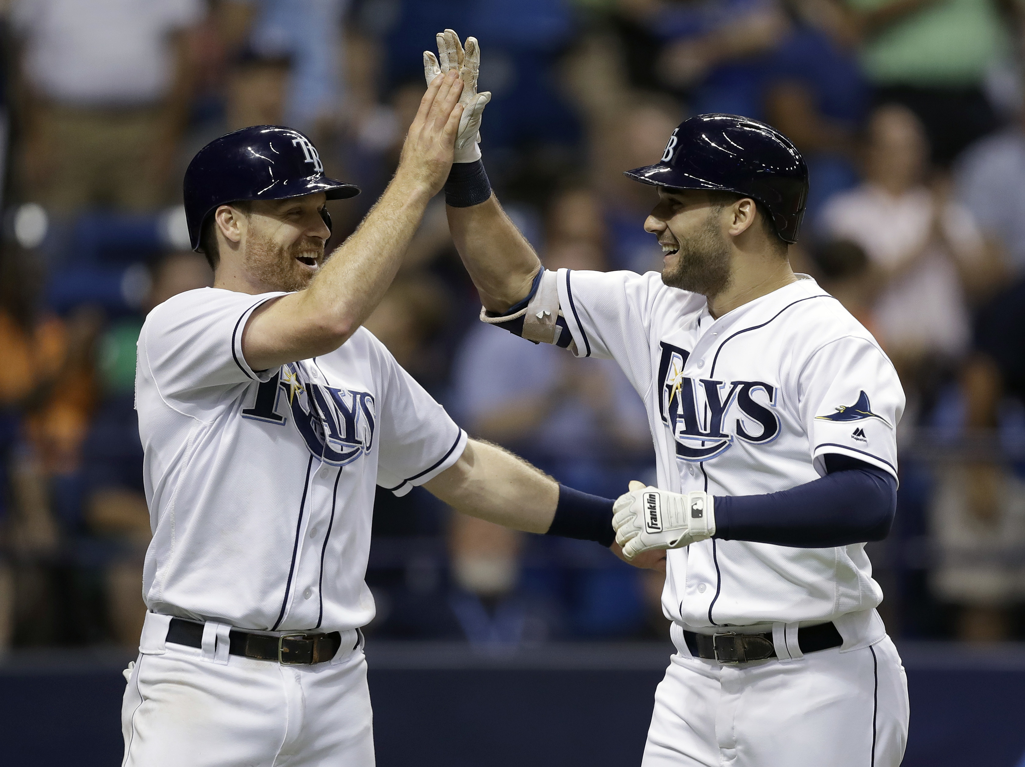 Tampa Bay Rays' Kevin Kiermaier, right, celebrates his two-run home run off Toronto Blue Jays relief pitcher Joe Biagini with teammate Logan Forsythe during the seventh inning of a baseball game Saturday, Sept. 3, 2016, in St. Petersburg, Fla. (AP Photo/C