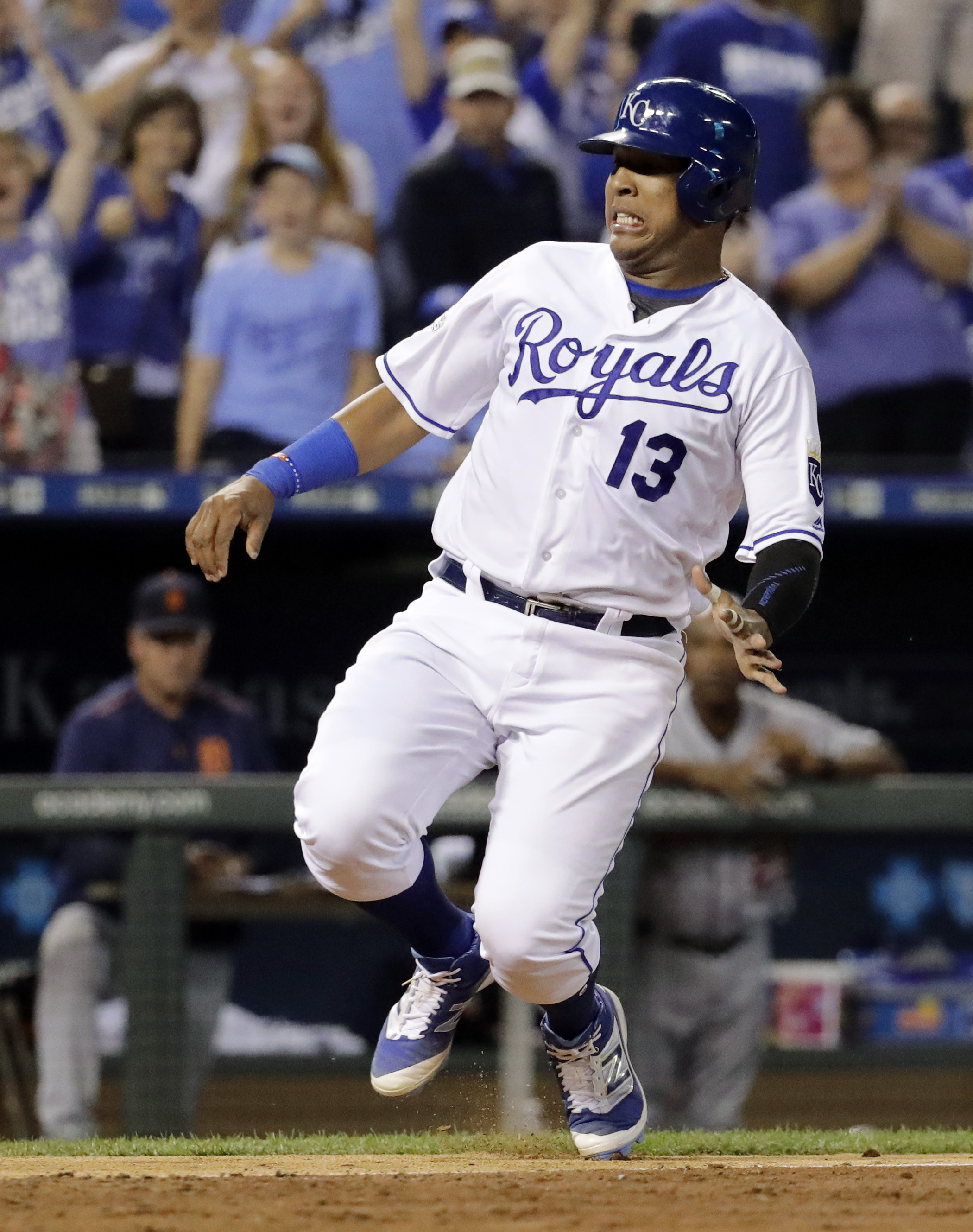 Kansas City Royals' Salvador Perez slides home to score an a two-run single by Alcides Escobar during the eighth inning of a baseball game against the Detroit Tigers on Saturday, Sept. 3, 2016, in Kansas City, Mo. (AP Photo/Charlie Riedel)