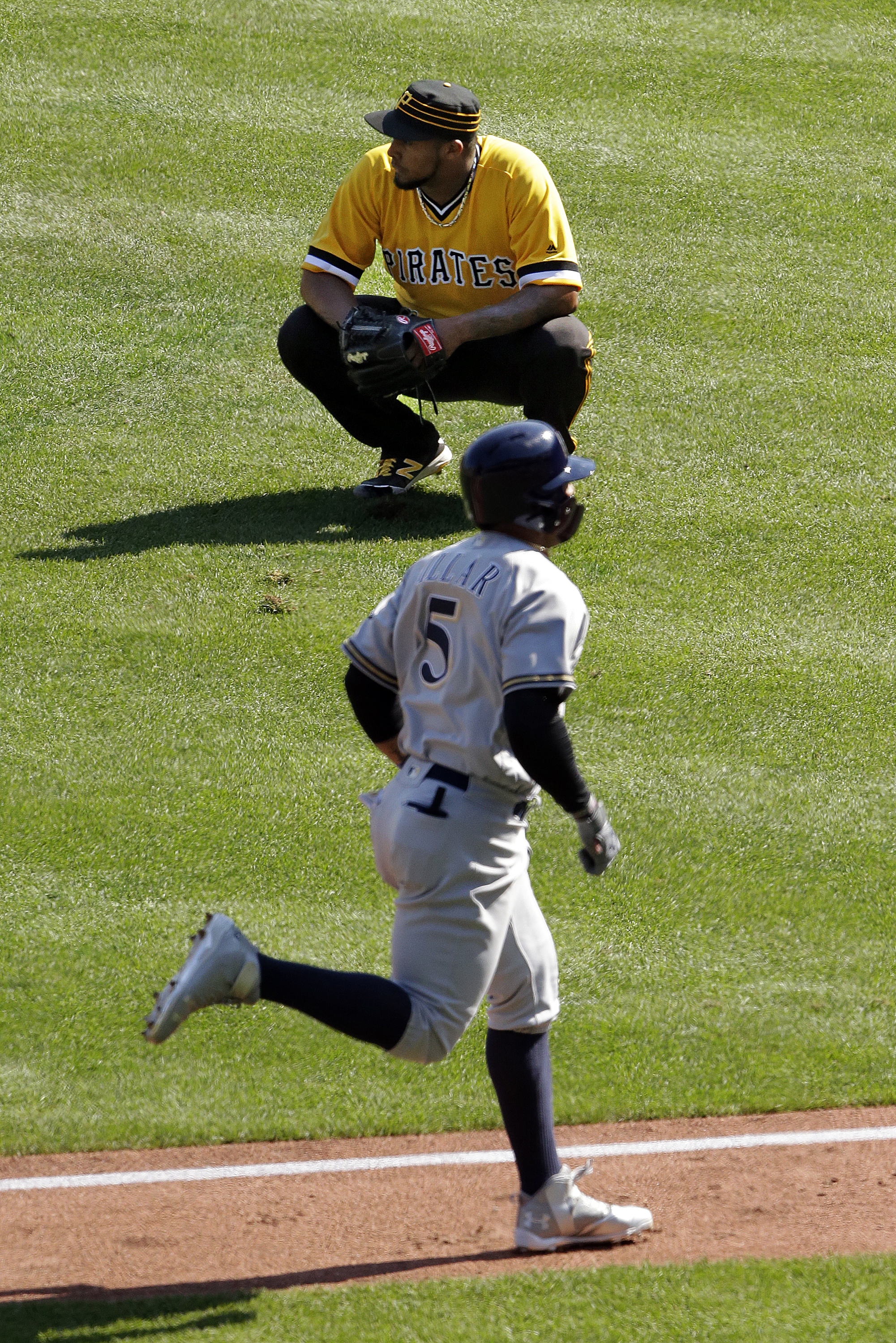 Milwaukee Brewers' Jonathan Villar (5) rounds third after hitting a grand slam off Pittsburgh Pirates relief pitcher Juan Nicasio, rear, during the sixth inning of a baseball game in Pittsburgh, Sunday, Sept. 4, 2016. (AP Photo/Gene J. Puskar)