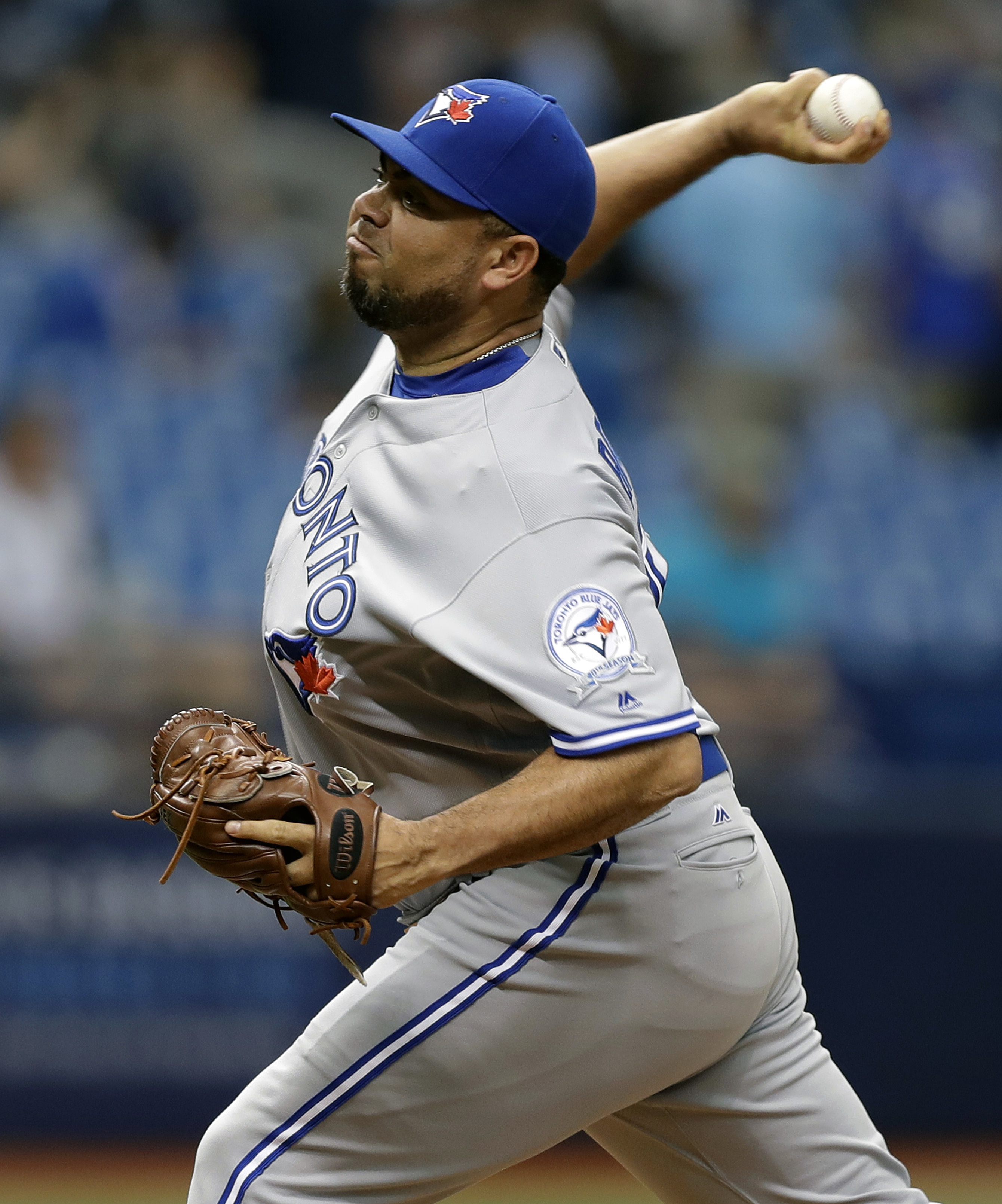 Toronto Blue Jays relief pitcher Joaquin Benoit delivers to the Tampa Bay Rays during the eighth inning of a baseball game Sunday, Sept. 4, 2016, in St. Petersburg, Fla. (AP Photo/Chris O'Meara)