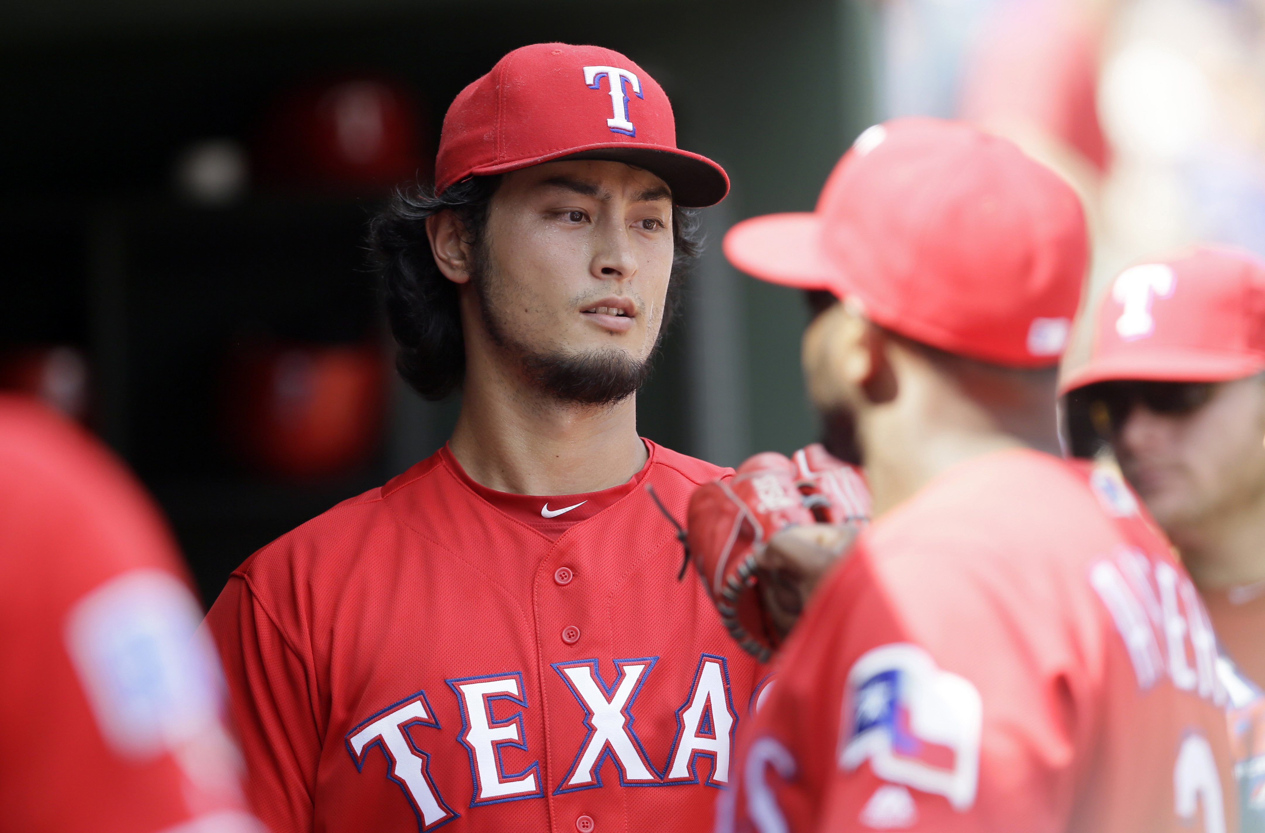Texas Rangers starting pitcher Yu Darvish, of Japan, walks into the dugout after the third inning of a baseball game against the Houston Astros in Arlington, Texas, Sunday, Sept. 4, 2016. (AP Photo/LM Otero)
