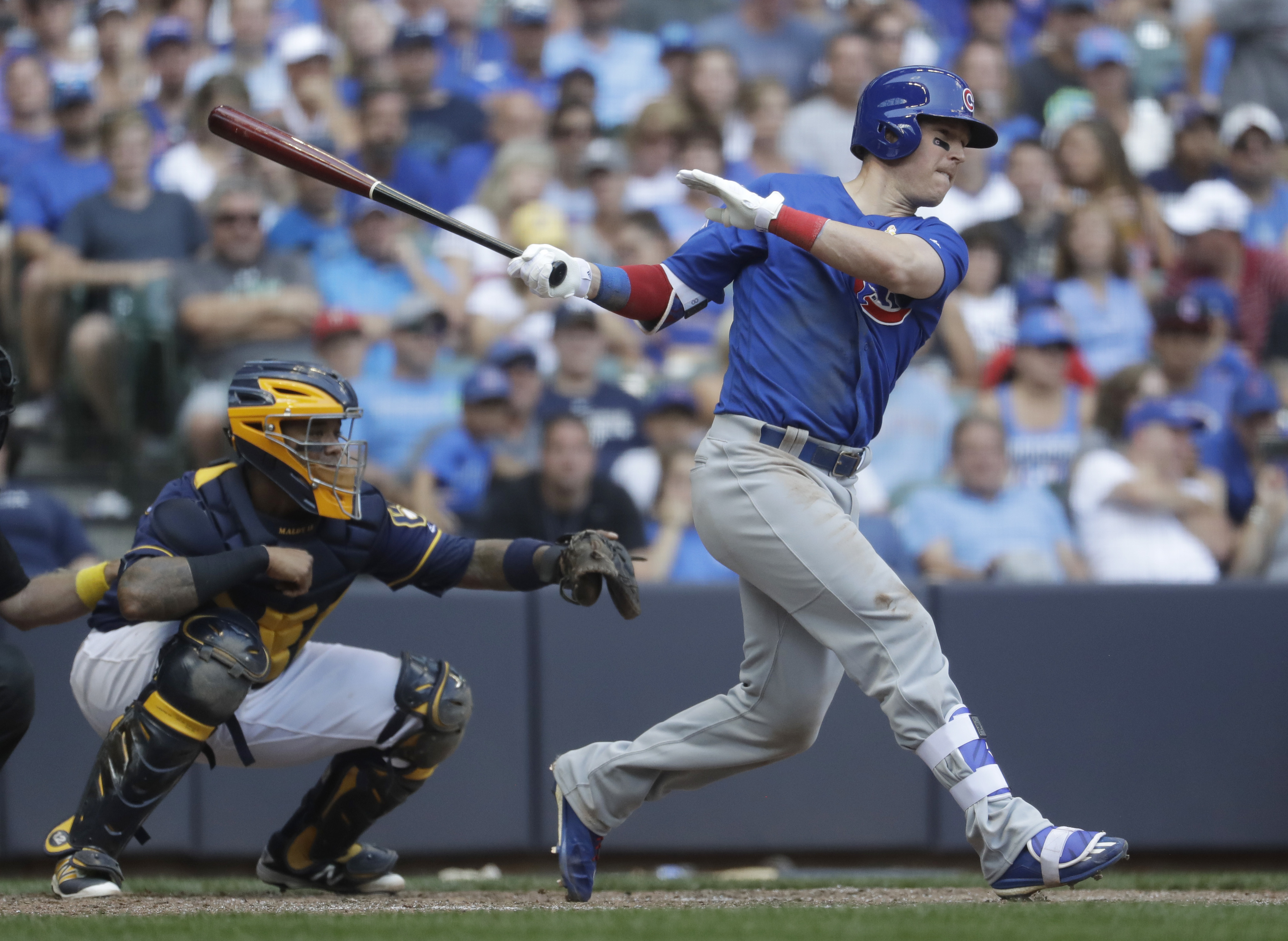Chicago Cubs' Chris Coghlan hits a two-run scoring single during the eighth inning of a baseball game against the Milwaukee Brewers Monday, Sept. 5, 2016, in Milwaukee. (AP Photo/Morry Gash)
