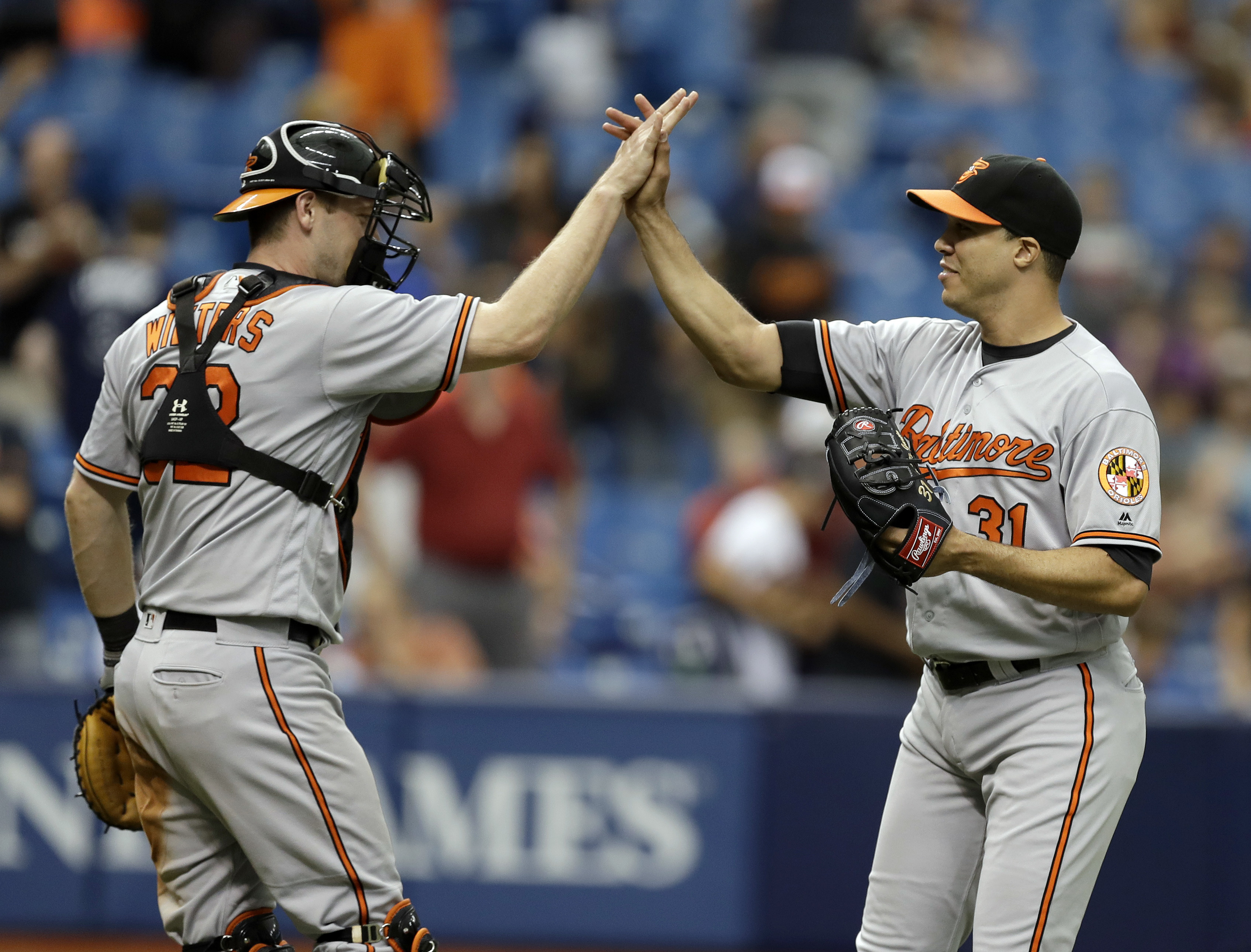 Baltimore Orioles starting pitcher Ubaldo Jimenez, right, high fives catcher Matt Wieters after closing out the Tampa Bay Rays during the ninth inning of a baseball game Monday, Sept. 5, 2016, in St. Petersburg, Fla. Jiminez pitched a complete game in the