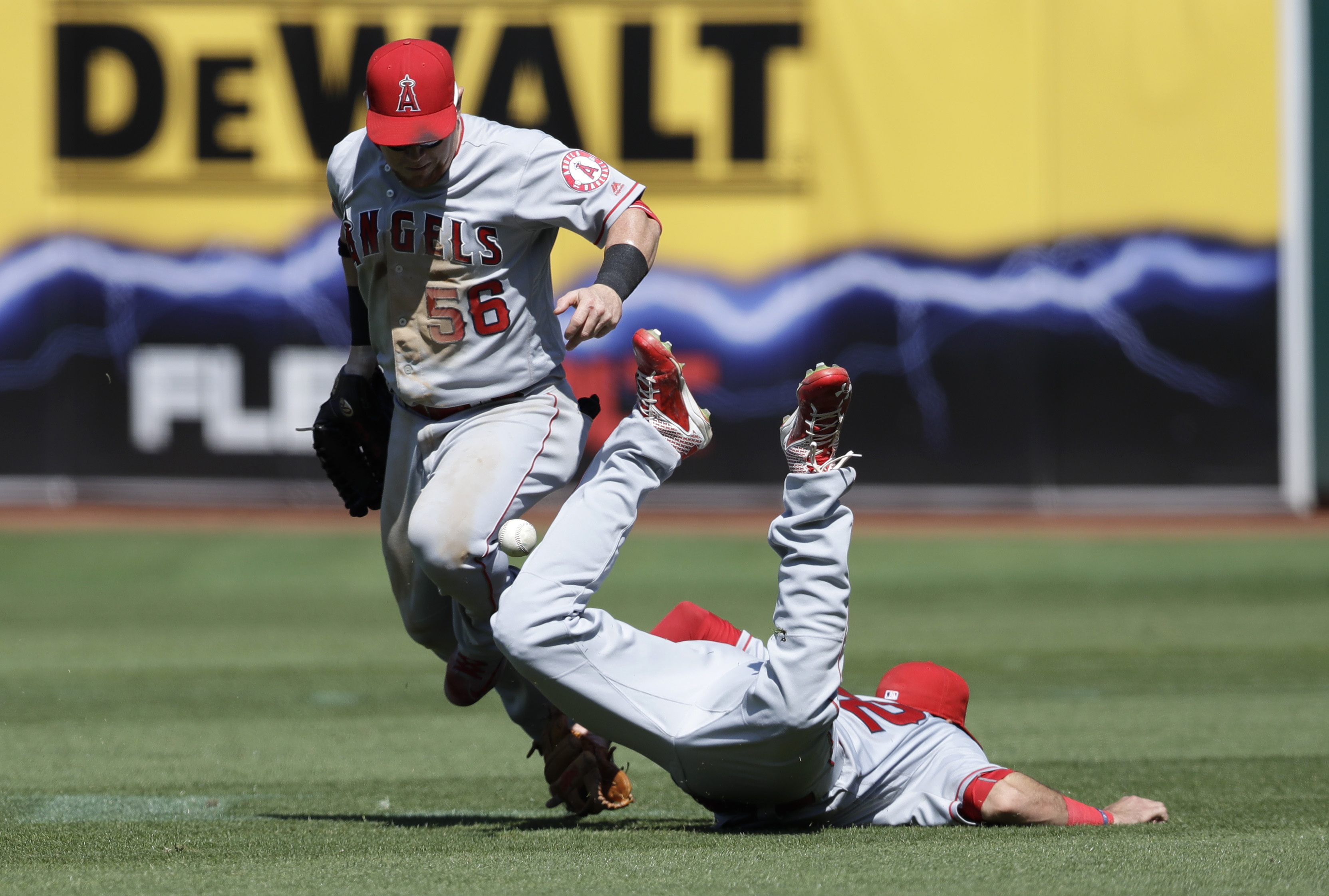 Los Angeles Angels second baseman Kaleb Cowart, bottom, collides with right fielder Kole Calhoun (56) on a double by Oakland Athletics' Danny Valencia during the fifth inning of a baseball game Monday, Sept. 5, 2016, in Oakland, Calif. (AP Photo/Marcio Jo