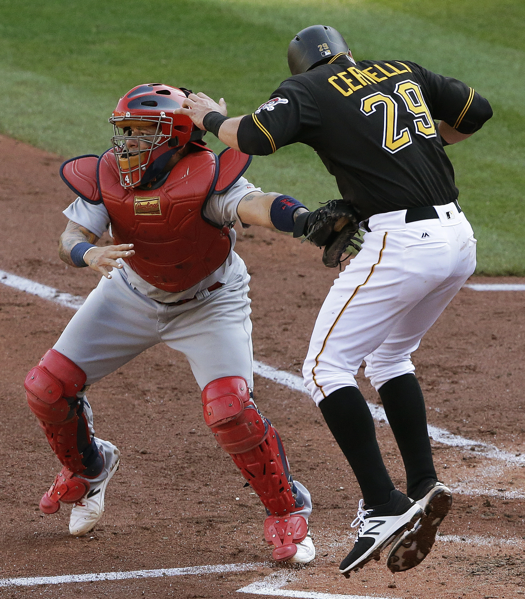 St. Louis Cardinals catcher Yadier Molina, left, tags out Pittsburgh Pirates' Francisco Cervelli, who was going on contact from third on a ground ball to third by Josh Harrison during the second inning of a baseball game in Pittsburgh, Monday, Sept. 5, 20