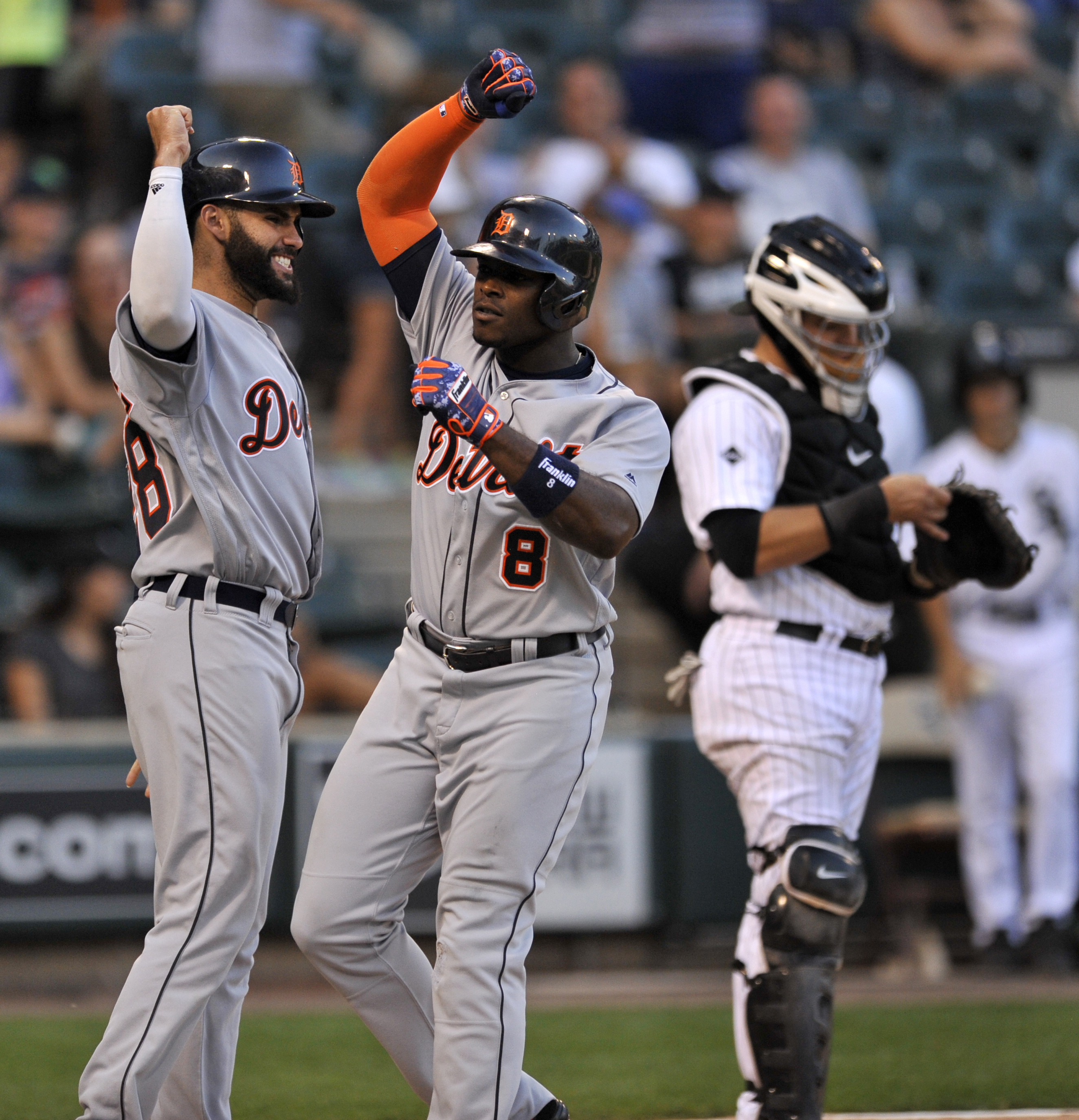Detroit Tigers' Justin Upton (8) celebrates with teammate Victor Martinez, left, at home plate after hitting a three-run home run during the 11h inning of a baseball game against the Chicago White Sox on Monday, Sept. 5, 2016, in Chicago. (AP Photo/Paul B