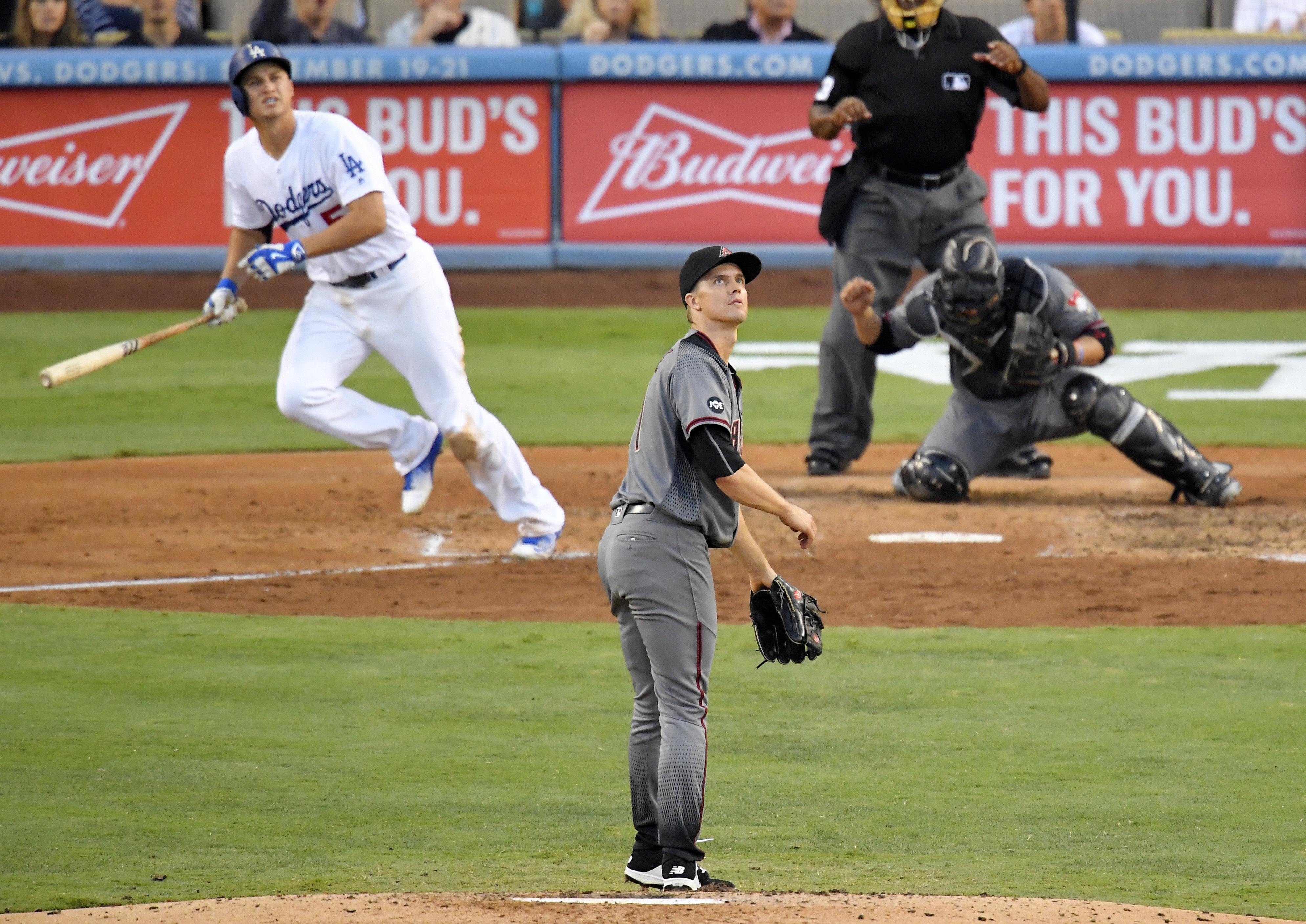 Los Angeles Dodgers' Corey Seager watches his three-run home run, along with Arizona Diamondbacks starting pitcher Zack Greinke, center, and catcher Welington Castillo during the fifth inning of a baseball game, Monday, Sept. 5, 2016, in Los Angeles. (AP