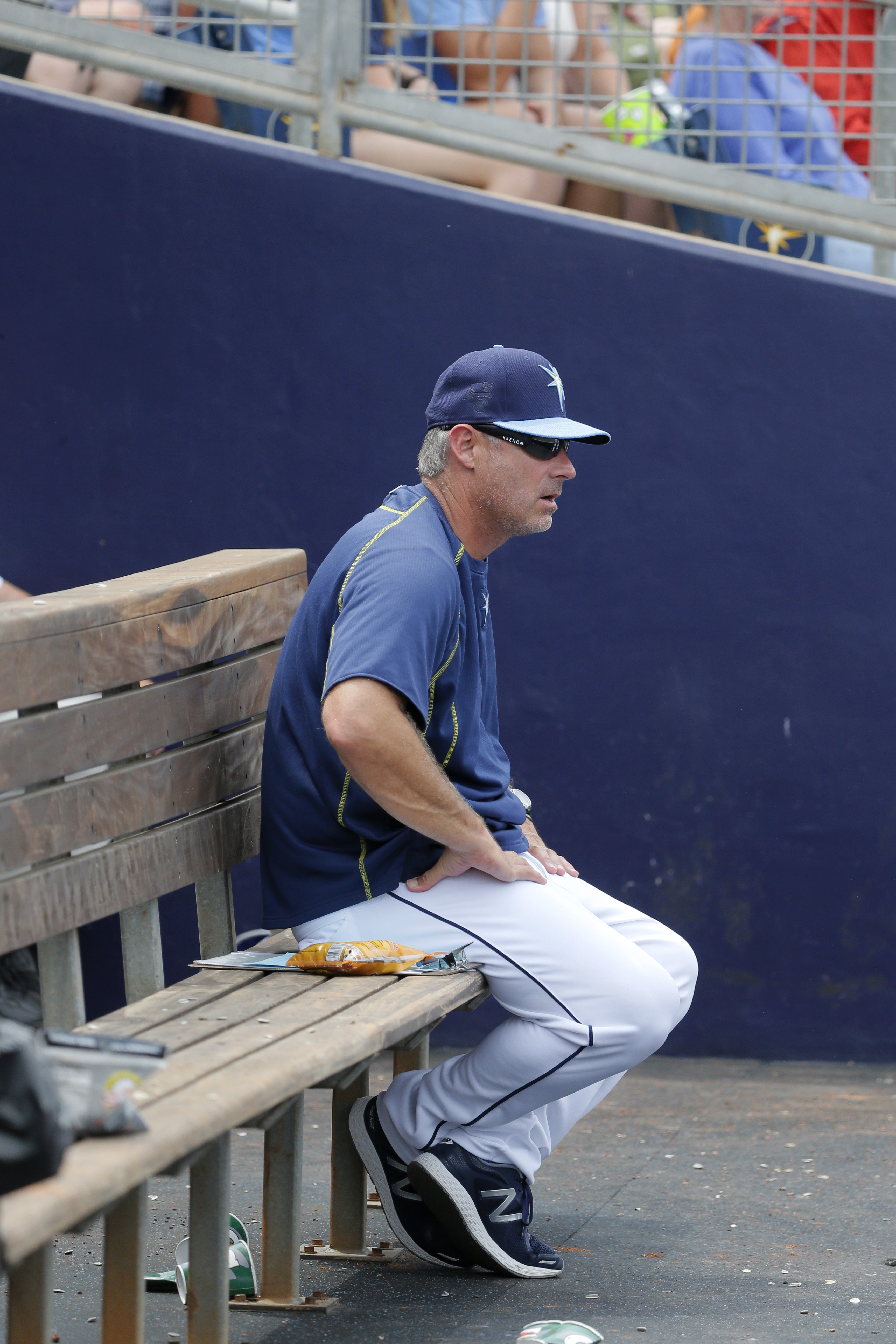 Tampa Bay Rays hitting coach Derek Shelton sits on the bench in the dugout during a spring training baseball game against the Minnesota Twins on Friday, March 25, 2016, in Port Charlotte, Fla. (AP Photo/Tony Gutierrez)