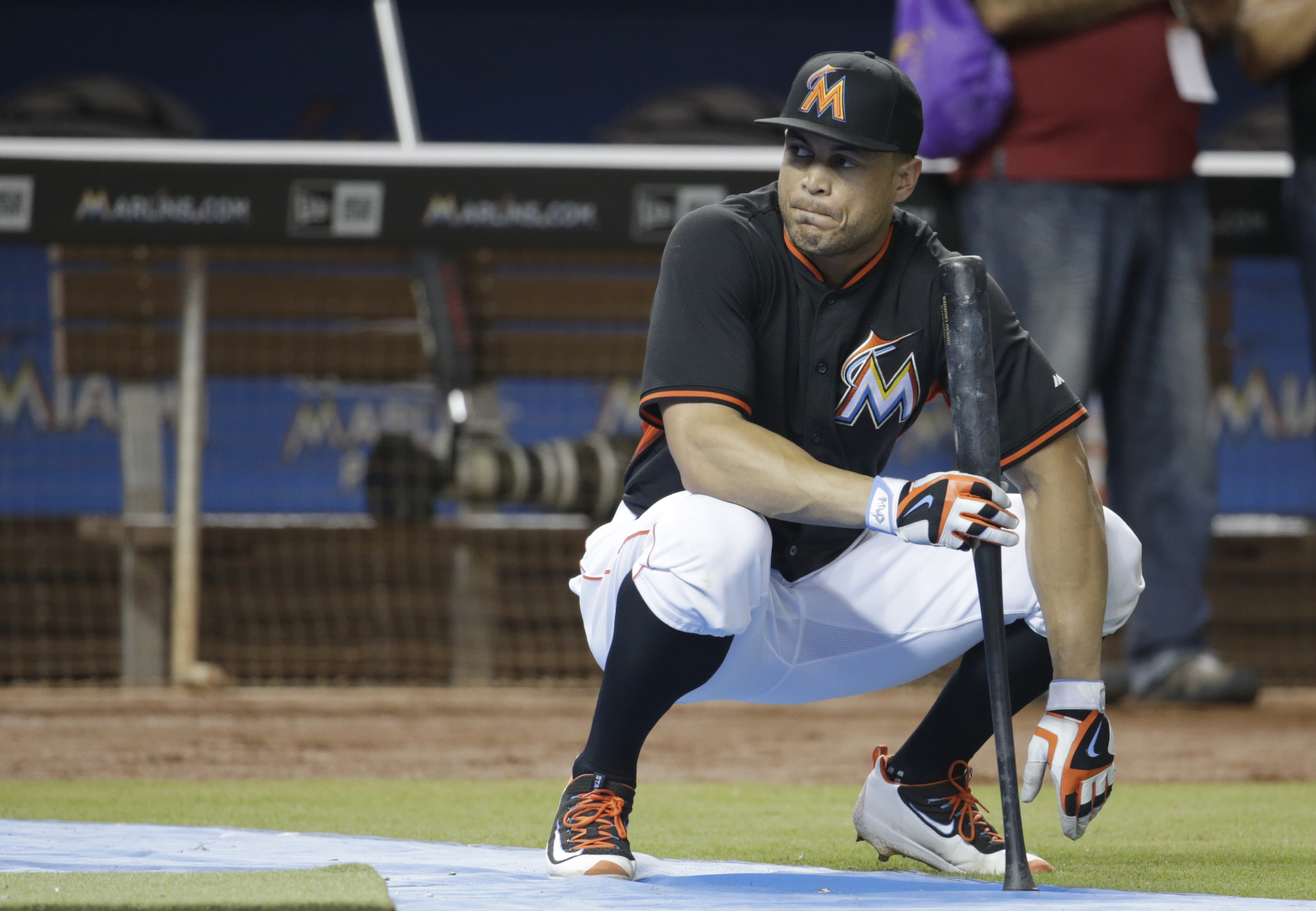 Miami Marlins' Giancarlo Stanton watches batting practice before a baseball game against the Philadelphia Phillies, Tuesday, Sept. 6, 2016, in Miami. The Marlins reinstated the Home Run Derby champion from the disabled list Tuesday, barely three weeks aft
