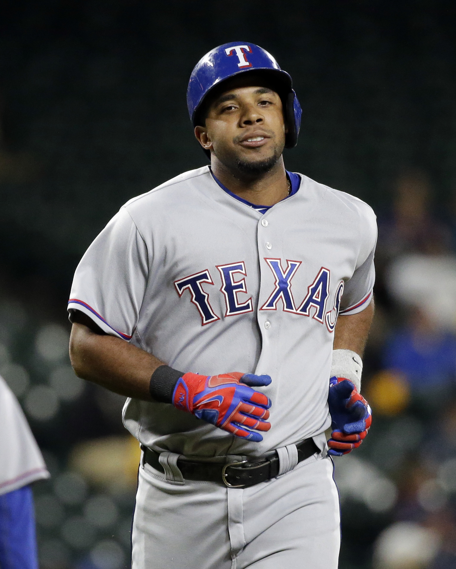 Texas Rangers' Elvis Andrus heads home on his home run against the Seattle Mariners during the seventh inning of a baseball game Tuesday, Sept. 6, 2016, in Seattle. (AP Photo/Elaine Thompson)