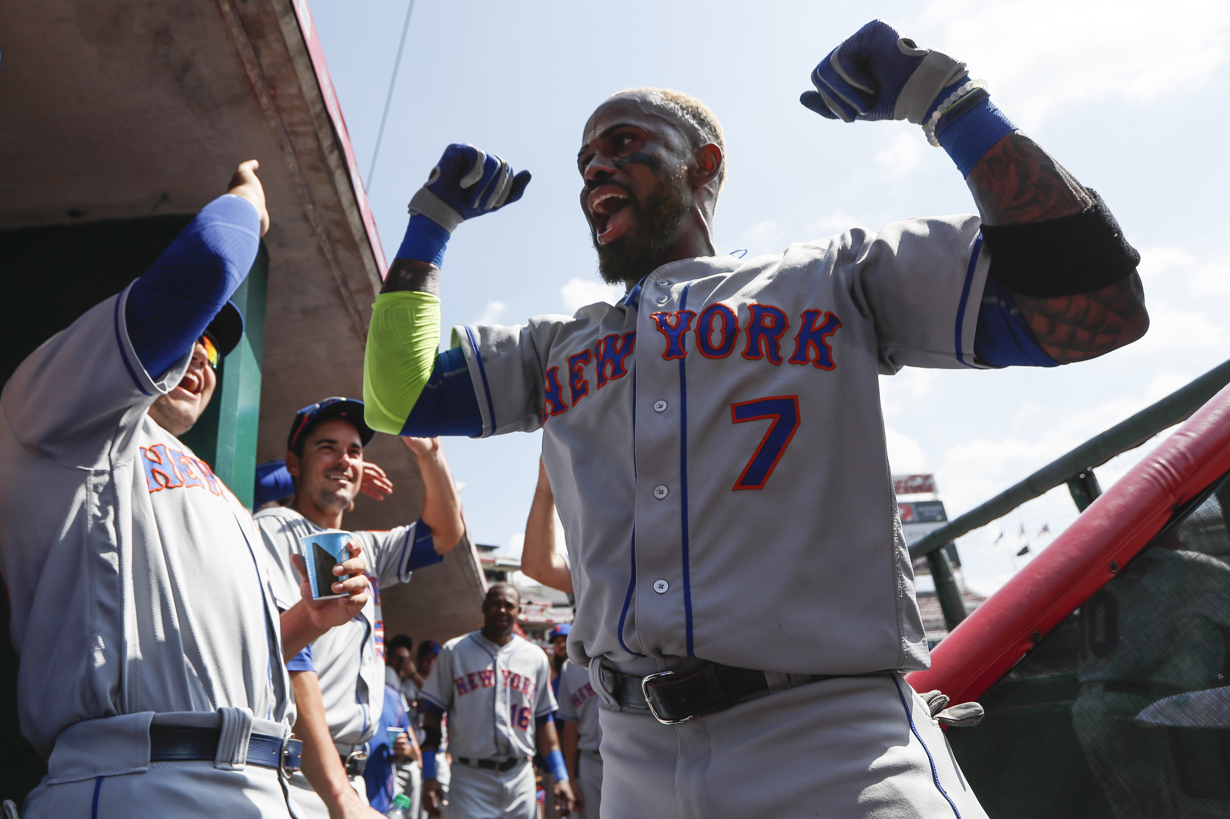 New York Mets' Jose Reyes celebrates in the dugout after hitting a solo home run off Cincinnati Reds starting pitcher Anthony DeSclafani in the first inning of a baseball game, Wednesday, Sept. 7, 2016, in Cincinnati. (AP Photo/John Minchillo)