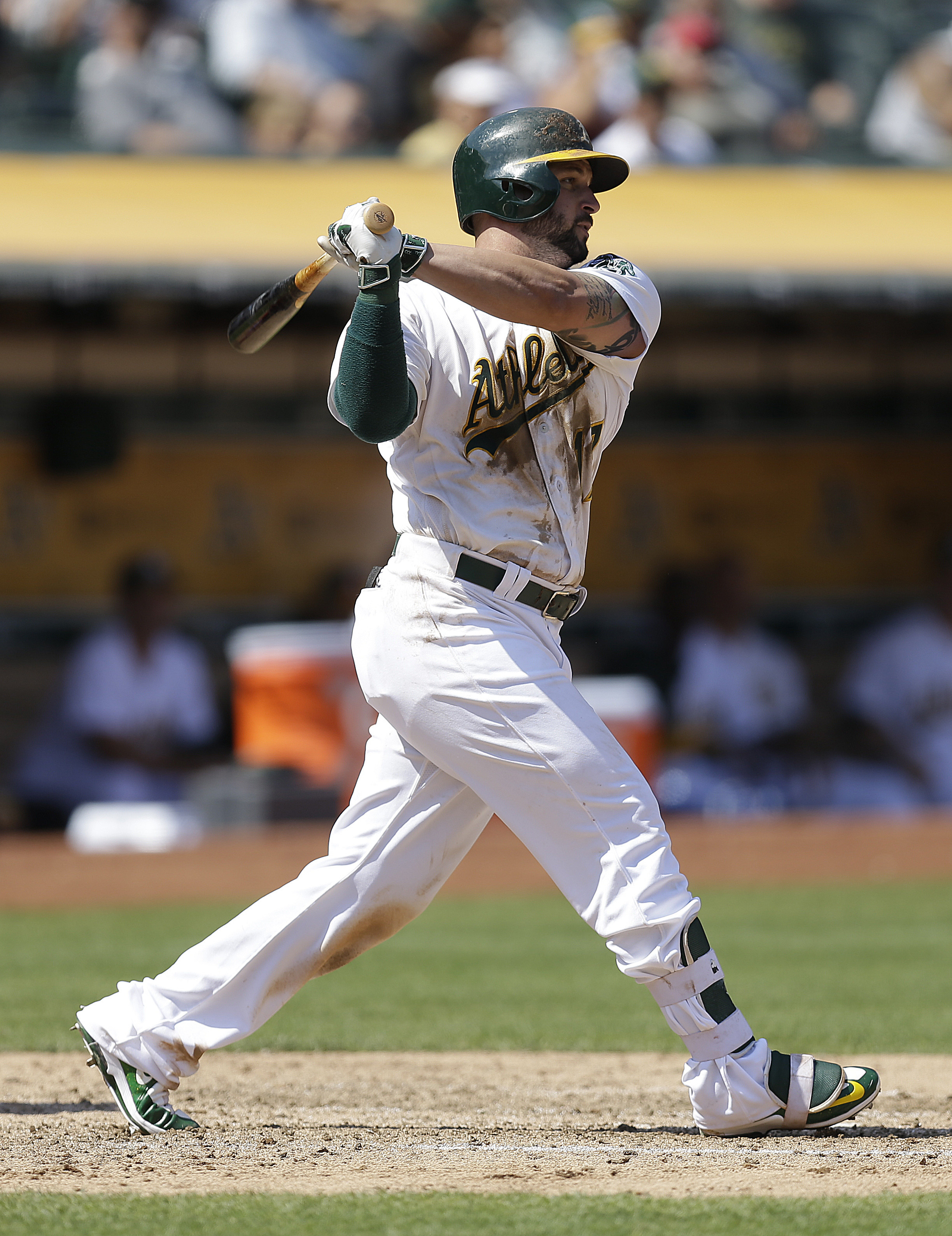 Oakland Athletics' Yonder Alonso swings for an RBI single off Los Angeles Angels' Jhoulys Chacin in the fifth inning of a baseball game Wednesday, Sept. 7, 2016, in Oakland, Calif. (AP Photo/Ben Margot)