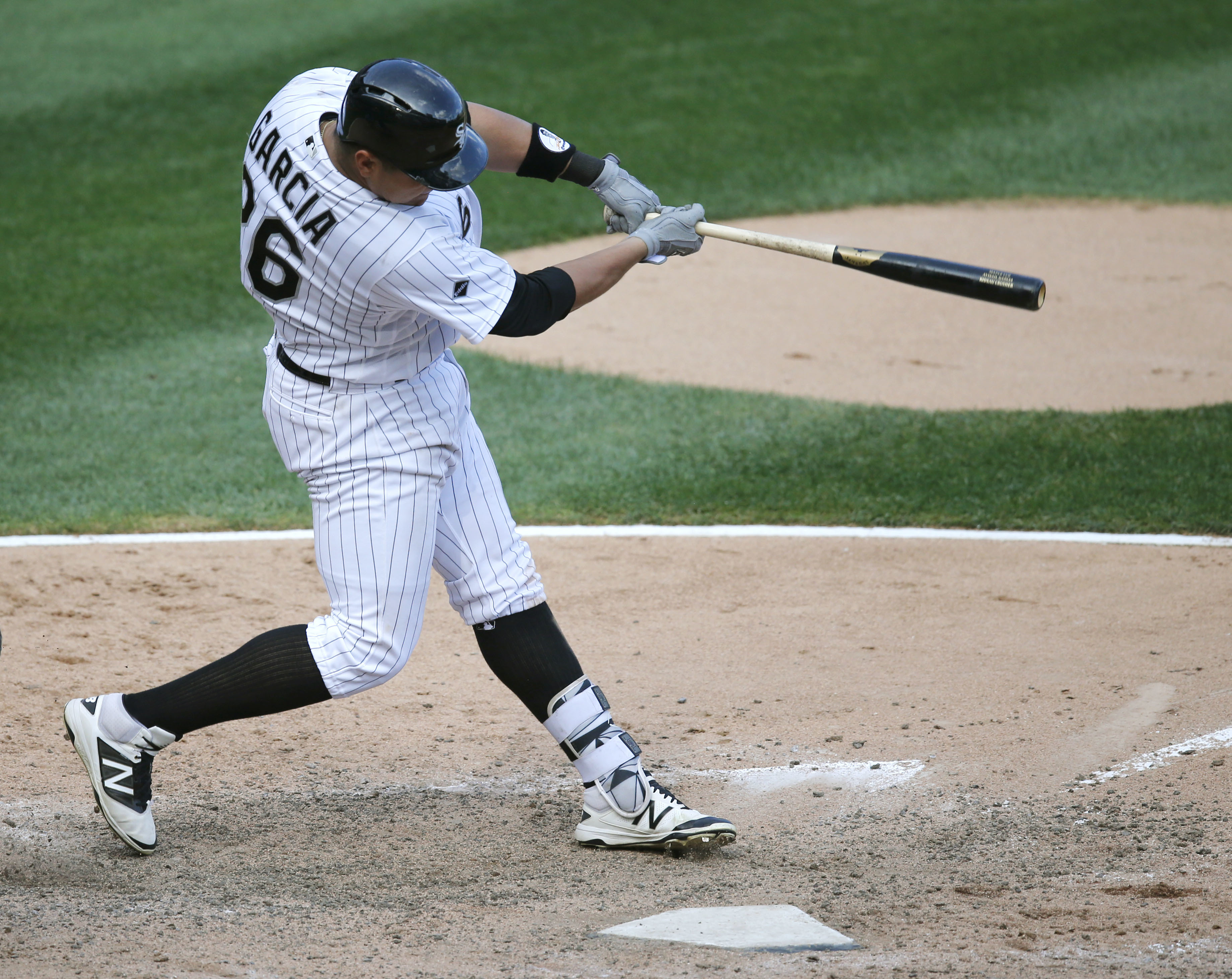 Chicago White Sox's Avisail Garcia hits an RBI single off Detroit Tigers' Shane Greene, scoring pinch-runner J.B. Shuck, during the eighth inning of a baseball game Wednesday, Sept. 7, 2016, in Chicago. (AP Photo/Charles Rex Arbogast)