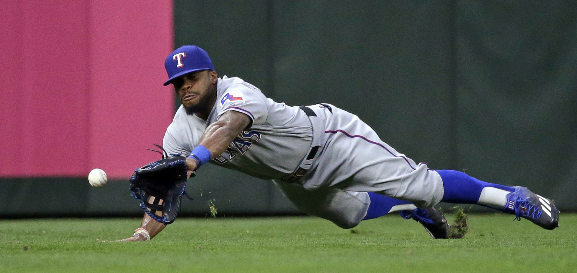 Texas Rangers center fielder Delino DeShields dives for, but misses, a double by Seattle Mariners' Seth Smith in the first inning of a baseball game Wednesday, Sept. 7, 2016, in Seattle. (AP Photo/Elaine Thompson)