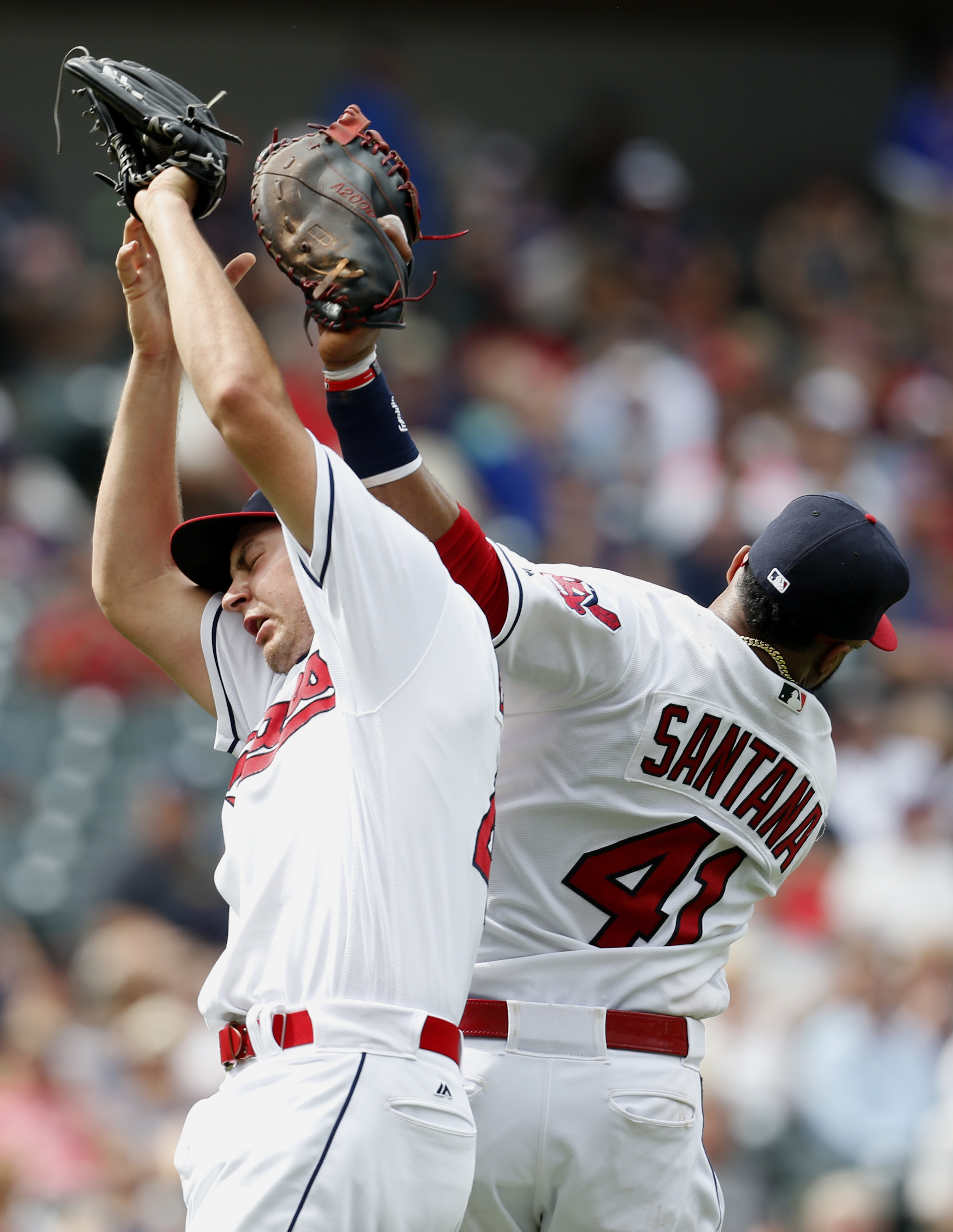 Cleveland Indians starting pitcher Trevor Bauer and Carlos Santana (41) collide on a pop out to the pitcher by Houston Astros' Jose Altuve during the fifth inning of a baseball game Thursday, Sept. 8, 2016, in Cleveland. (AP Photo/Ron Schwane)