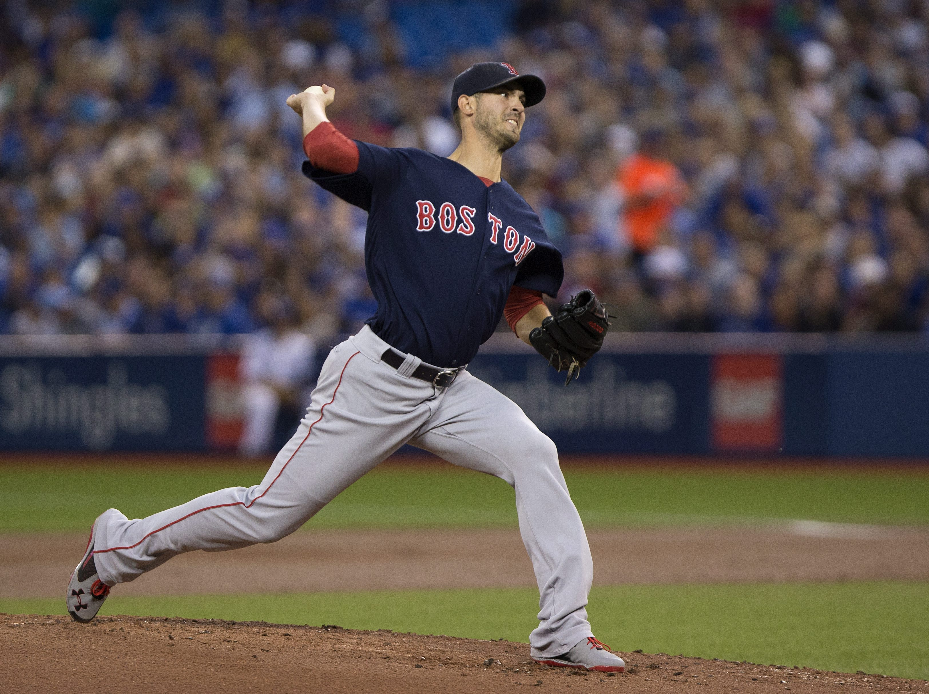 Boston Red Sox starting pitcher Rick Porcello delivers during first-inning baseball game action against the Toronto Blue Jays in Toronto, Friday, Sept. 9, 2016. (Peter Power/The Canadian Press via AP)