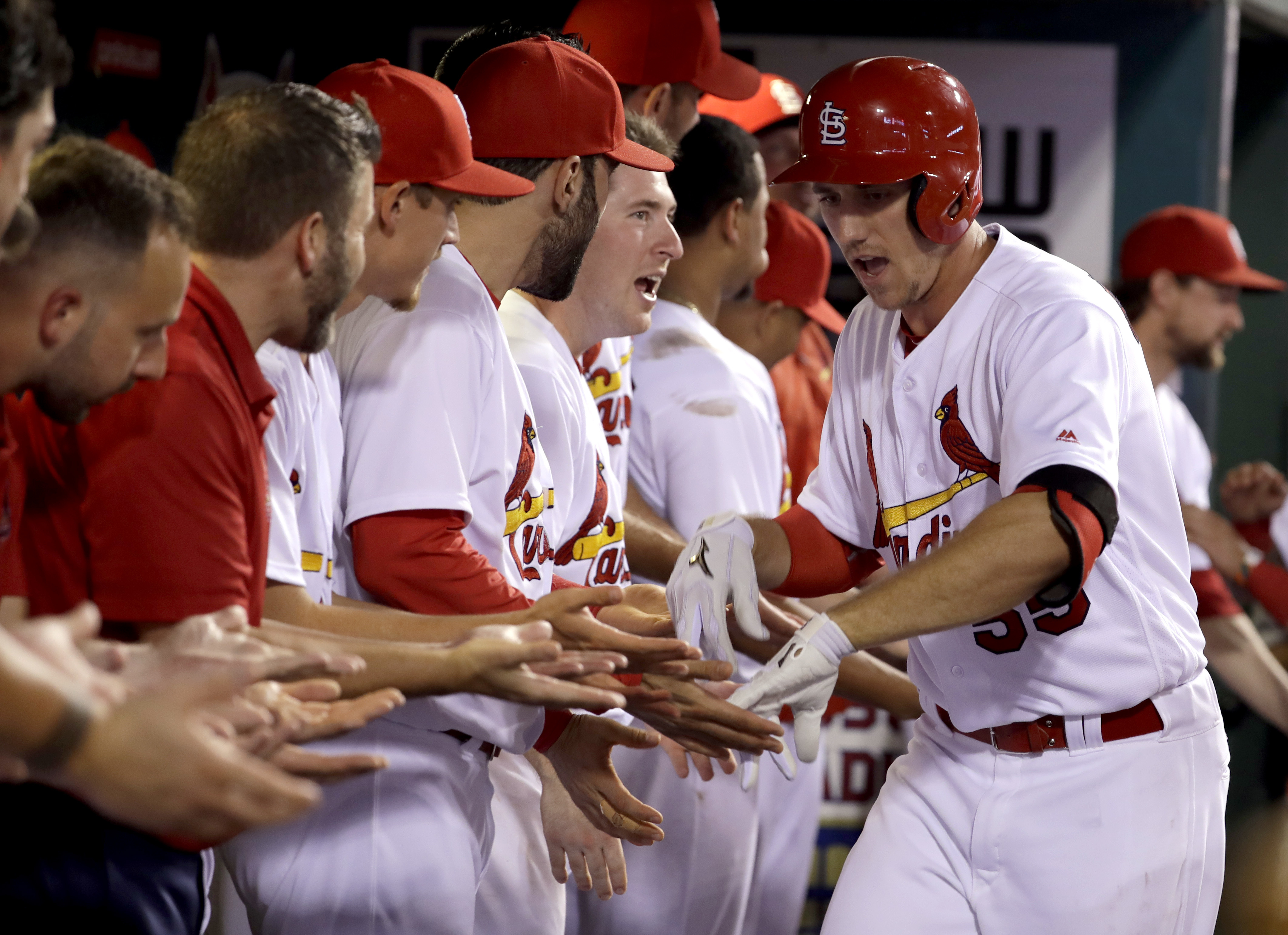 St. Louis Cardinals' Stephen Piscotty, right, is congratulated by teammates after hitting a two-run home run during the third inning of a baseball game against the Milwaukee Brewers on Friday, Sept. 9, 2016, in St. Louis. (AP Photo/Jeff Roberson)