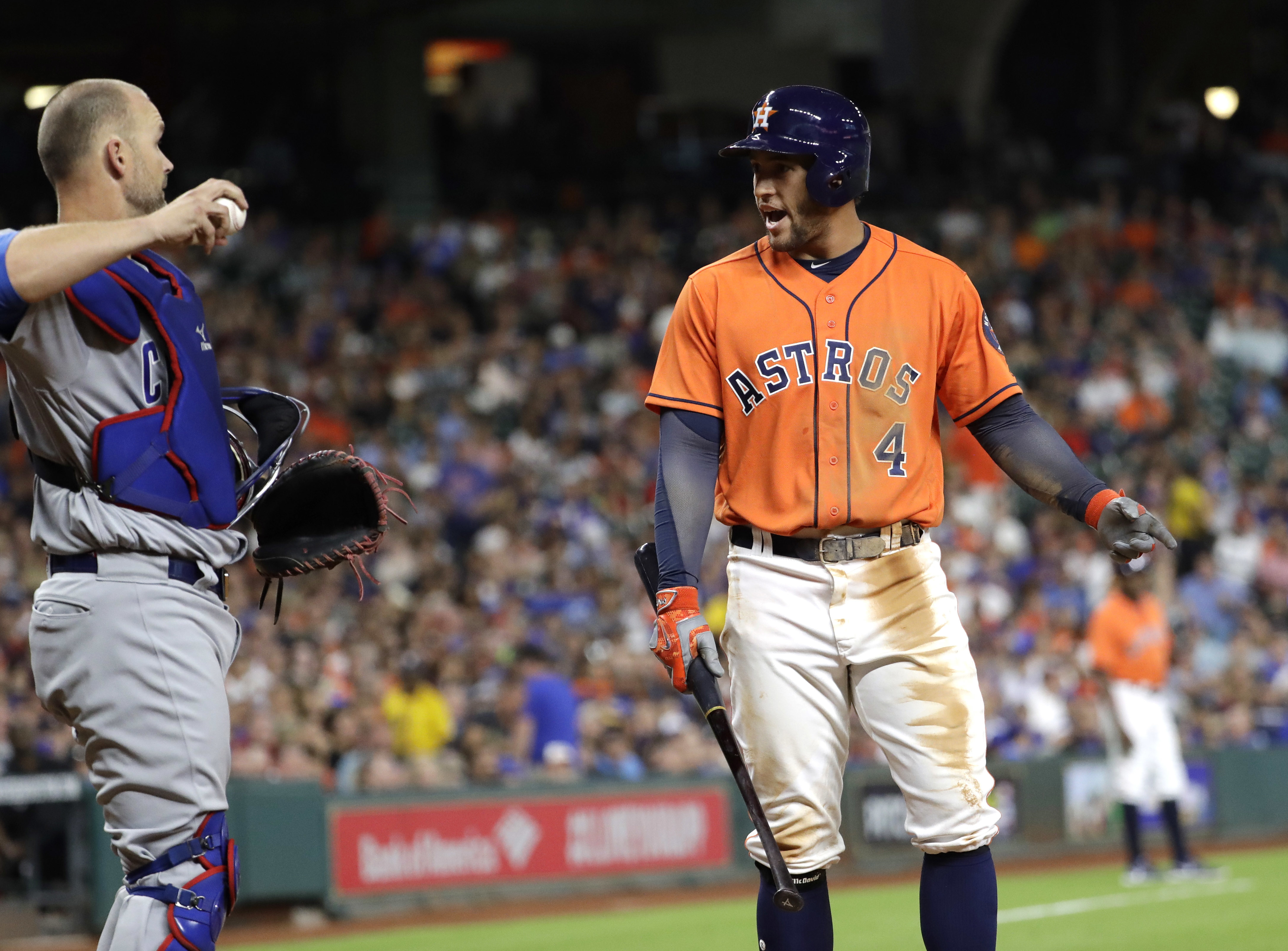 Houston Astros' George Springer (4) reacts after striking out as Chicago Cubs catcher David Ross throws the ball back to starting pitcher Jon Lester during the sixth inning of a baseball game Friday, Sept. 9, 2016, in Houston. (AP Photo/David J. Phillip)