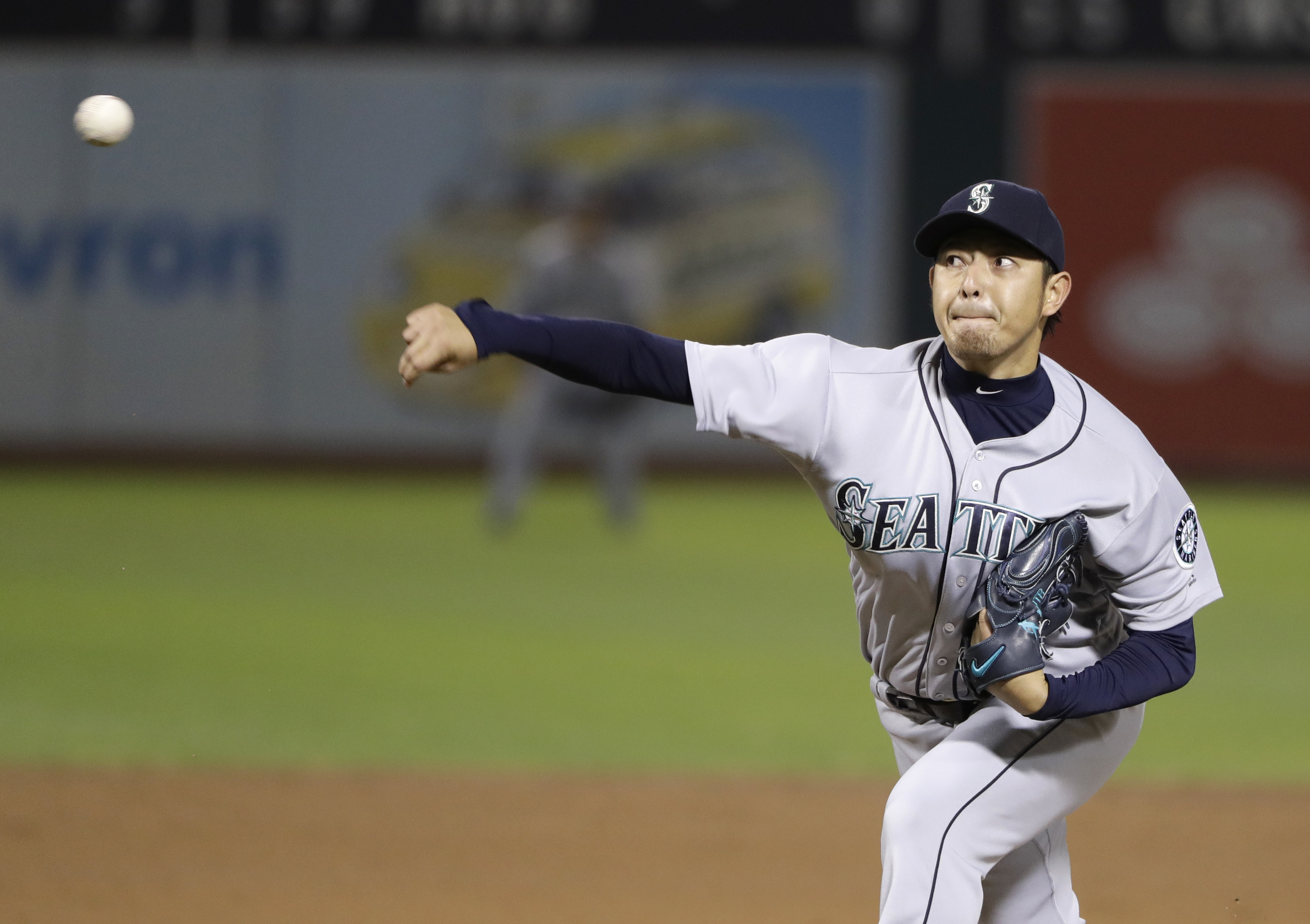Seattle Mariners starting pitcher Hisashi Iwakuma throws to the Oakland Athletics during the sixth inning of a baseball game Friday, Sept. 9, 2016, in Oakland, Calif. (AP Photo/Marcio Jose Sanchez)