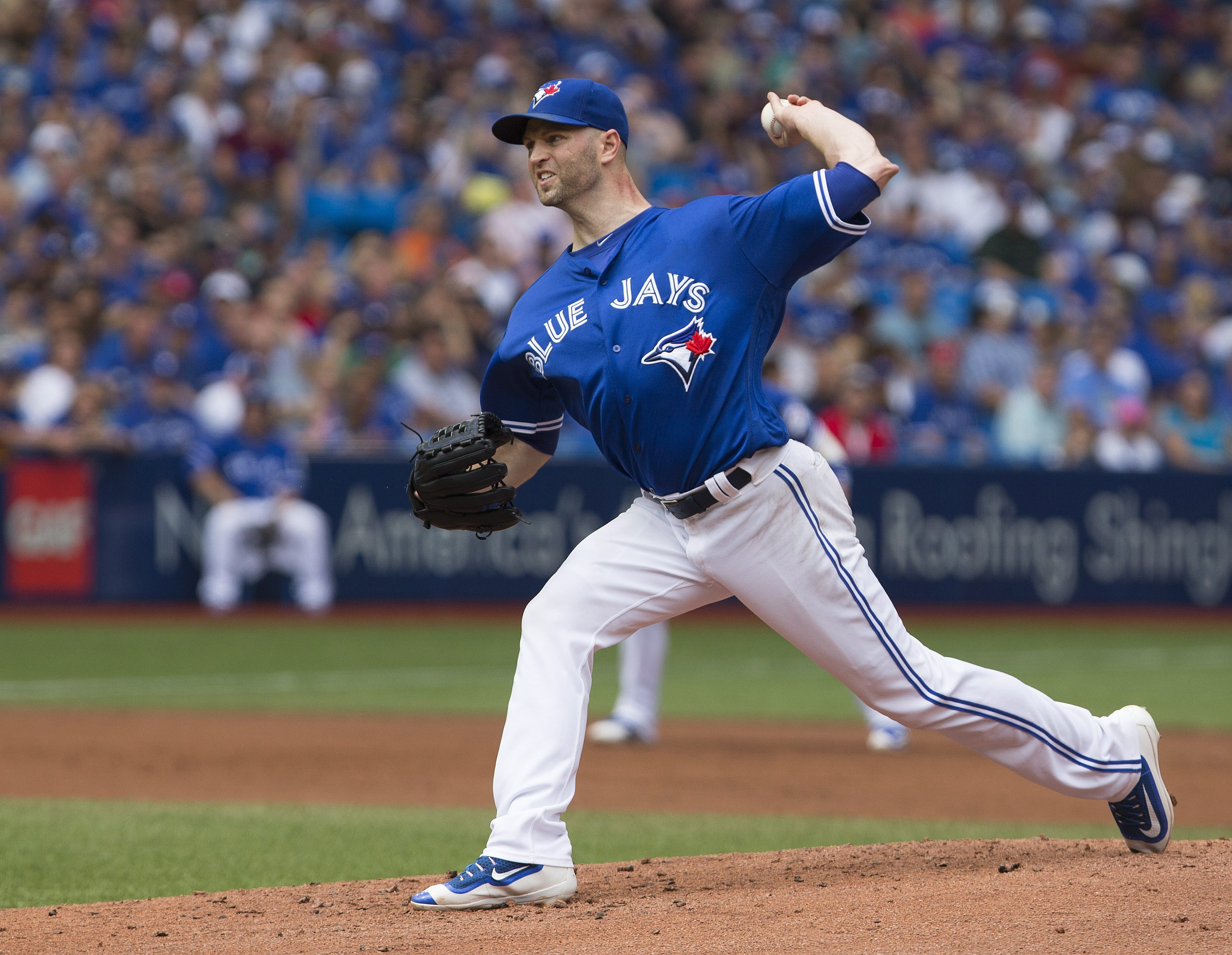Toronto Blue Jays starting pitcher J.A. Happ (33) delivers a pitch against the Boston Red Sox during the second inning of a baseball game in Toronto, Saturday, Sept. 10, 2016. (Peter Power/The Canadian Press via AP)