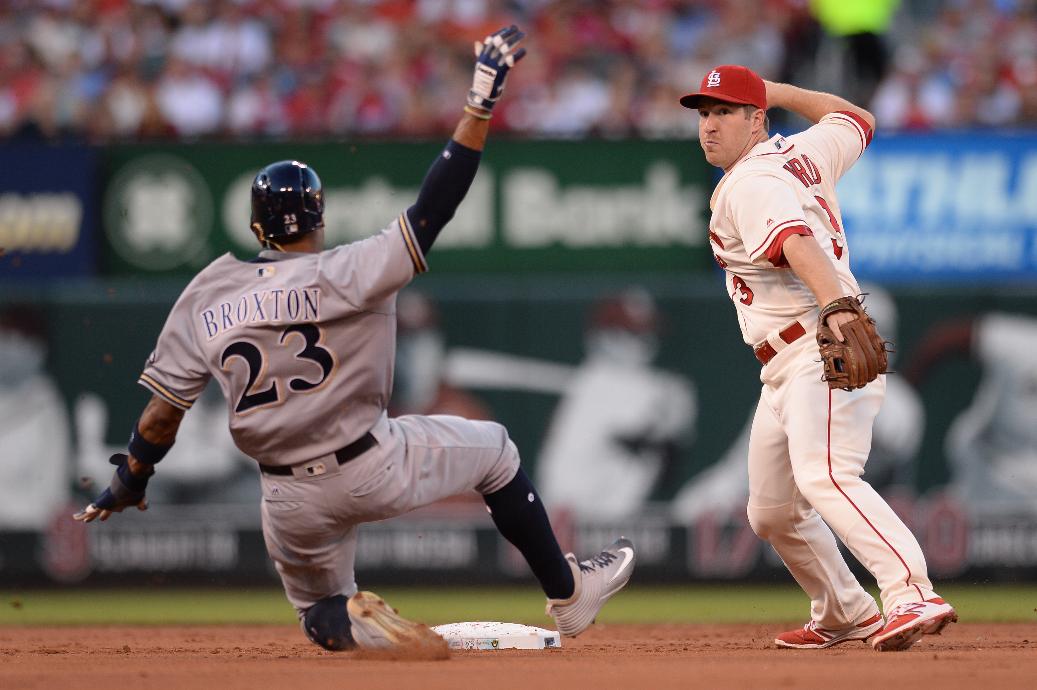 St. Louis Cardinals shortstop Jedd Gyorko (3) turns a double play as Milwaukee Brewers' Keon Broxton (23) slides into second base during the second inning of a baseball game between the St. Louis Cardinals and the Milwaukee Brewers on Saturday, Sep. 10, 2