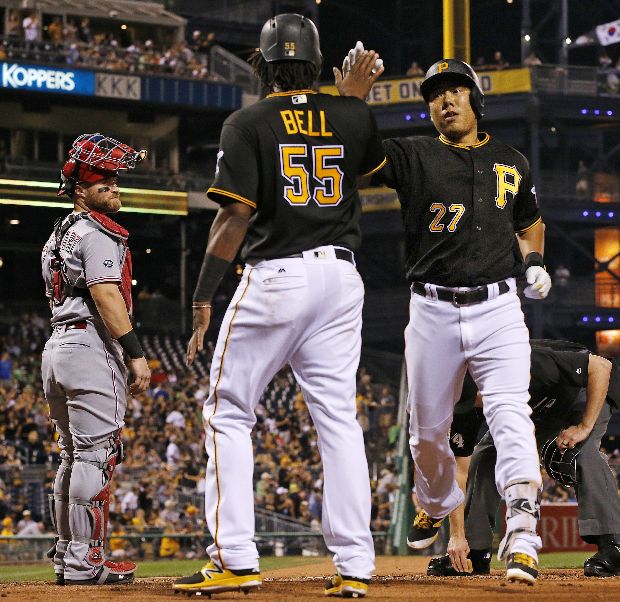 Pittsburgh Pirates' Jung Ho Kang (27) celebrates with Josh Bell (55) after hitting a two-run home run off Cincinnati Reds starting pitcher Robert Stephenson during the third inning of a baseball game in Pittsburgh, Saturday, Sept. 10, 2016. (AP Photo/Gene
