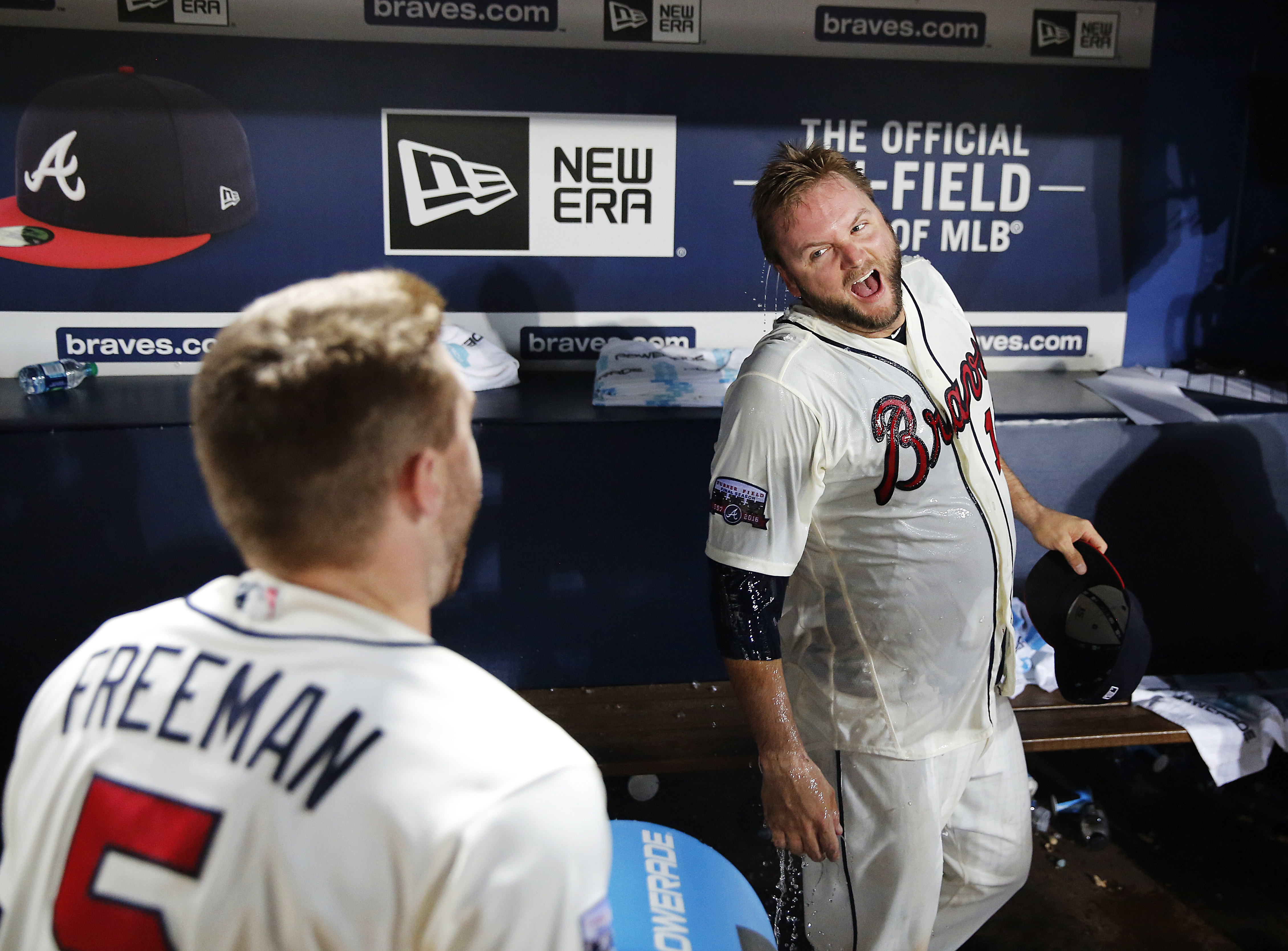 Atlanta Braves' A.J. Pierzynski, right, reacts after being doused by teammate Freddie Freeman after they defeated the New York Mets in a baseball game in Atlanta, Saturday, Sept. 10, 2016. (AP Photo/David Goldman)