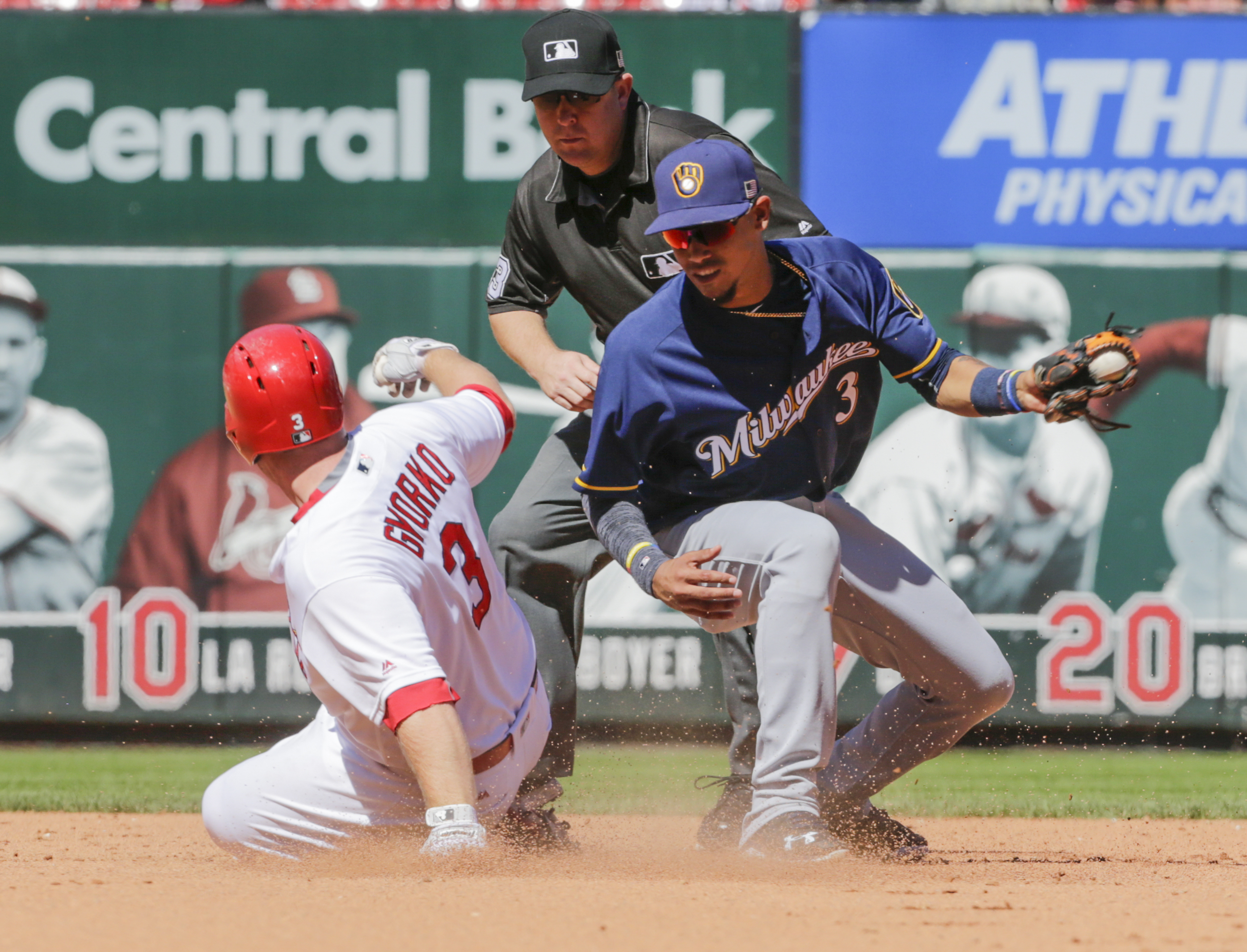 St. Louis Cardinals' Jed Gyorko (3) slides in safe to second as Milwaukee Brewers shortstop Orlando Arcia (3) spins to make the late tag in the fifth inning of a baseball game, Sunday, Sept. 11, 2016, in St. Louis. (AP Photo/Tom Gannam)