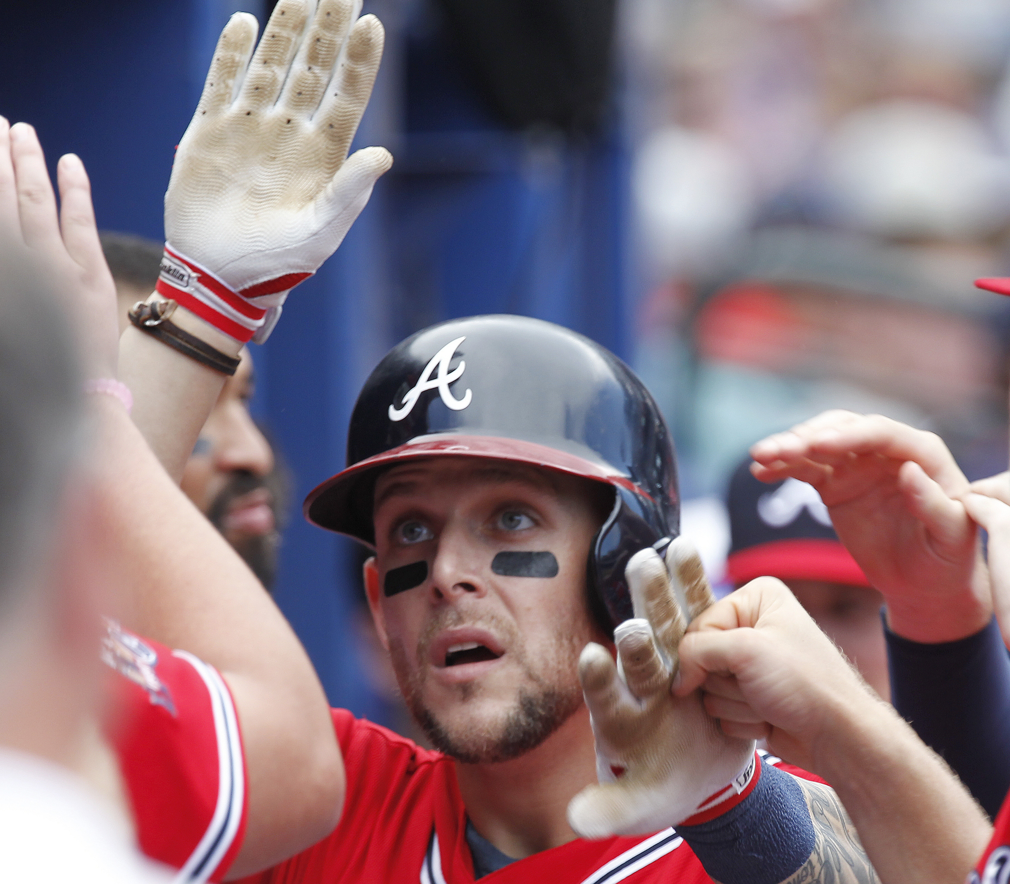 Atlanta Braves' Brandon Snyder is congratulated in the dugout after a solo home run off New York Mets starting pitcher Seth Lugo in the seventh inning of a baseball game in Atlanta Sunday, Sept. 11, 2016. (AP Photo/Tami Chappell)