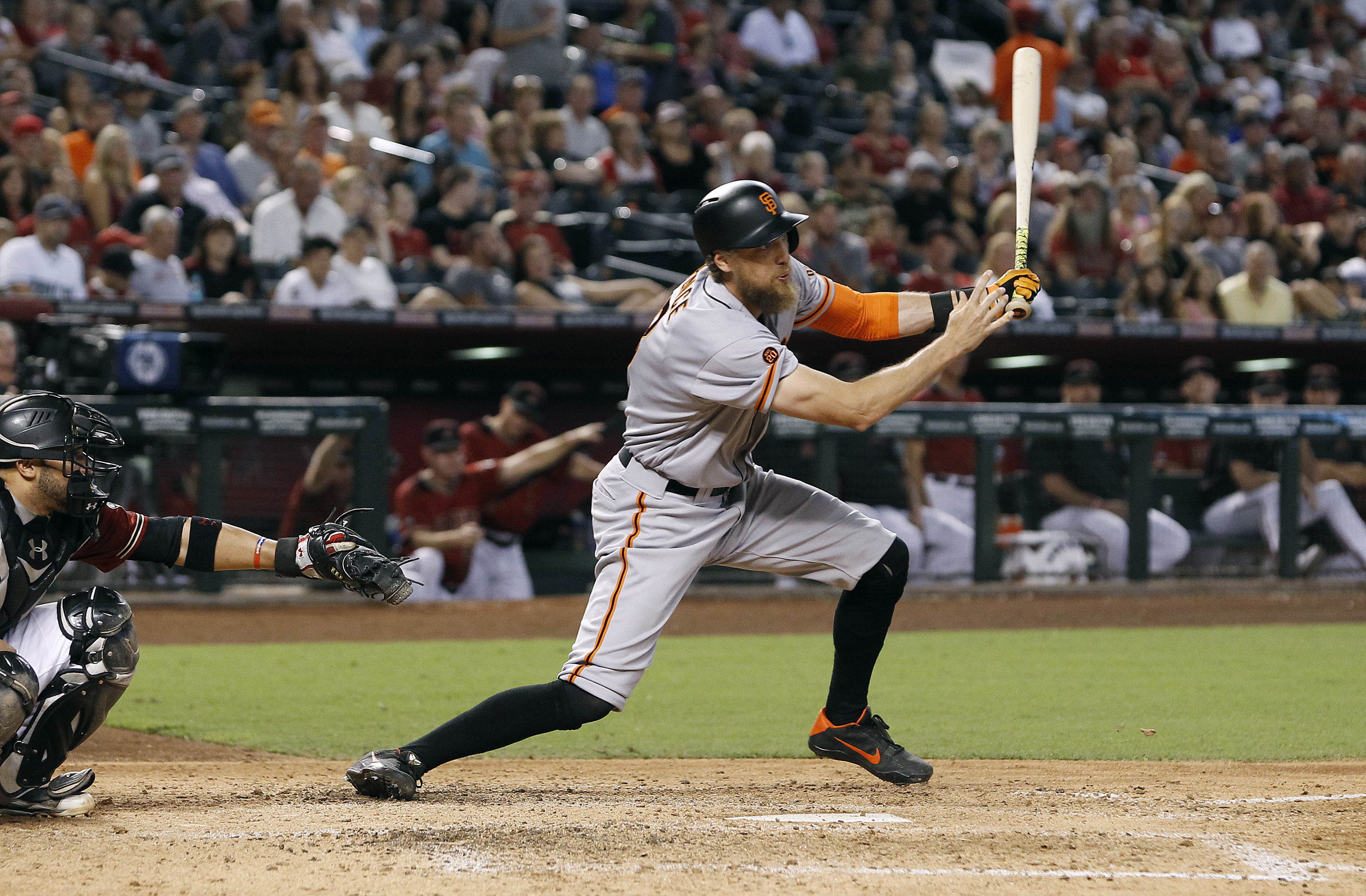 San Francisco Giants' Hunter Pence hits a double against the Arizona Diamondbacks during the seventh inning of a baseball game, Sunday, Sept. 11, 2016, in Phoenix. (AP Photo/Ralph Freso)
